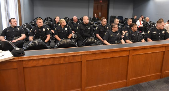 A dozen uniformed Mansfield police officers showed up Friday morning in support of Mansfield police Officer Paul Webb during the sentencing of Bradley Brewer.
