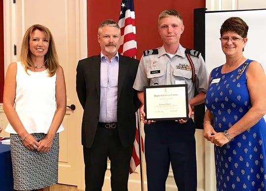 From left, Mr. and Mrs. Schemel, DAR JROTC award recipient Zacharia Schemel, DAR JROTC Chairwoman Sally Snyder.