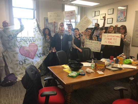 Graduate students occupy UW-Madison Graduate School Dean William Karpus'  office Friday, April 26, 2019.