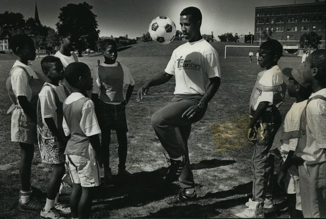 Jimmy Banks, then a defender with the Milwaukee Wave, demonstrates a ball-handling maneuver to youngsters at a Jimmy Banks City Soccer League camp at Johnsons Park, N. 19th Street and W. Fond du Lac Avenue in 1991.