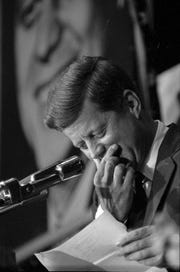 """This photo of President John F. Kennedy's visit to Milwaukee is dated May 12, 1962. The original caption reads, """"In his speech at the Arena, Mr. Kennedy said that he eventually would visit Mukwonago (Waukesha County) as he had promised in 1960. He made the promise after he was forced to pass up a scheduled campaign appearance there. He had some difficulty in pronouncing Mukwonago, checked his script, and finally said it right."""""""