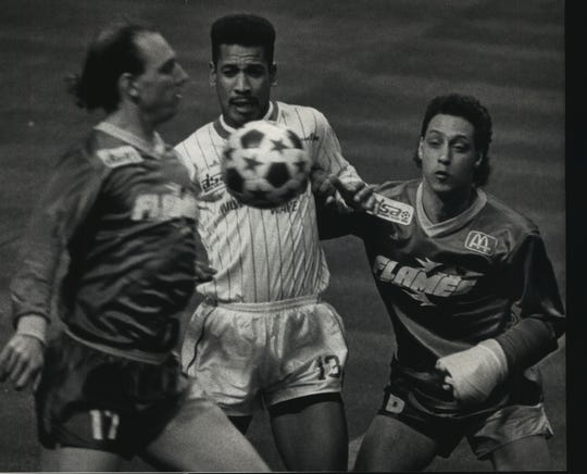 Milwaukee's Jimmy Banks (middle) battles with Fort Wayne's Robert Ryerson (left) and Alan Bodenstein during a 1989 Wave-Flames game at the Bradley Center.