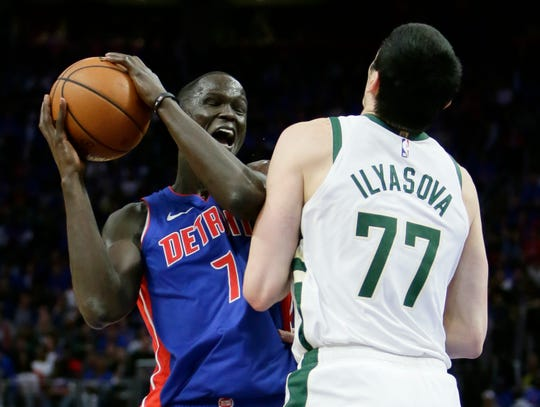Thon Maker collides with Ersan Ilyasova while going to the basket in the Pistons-Bucks first-round playoff series.