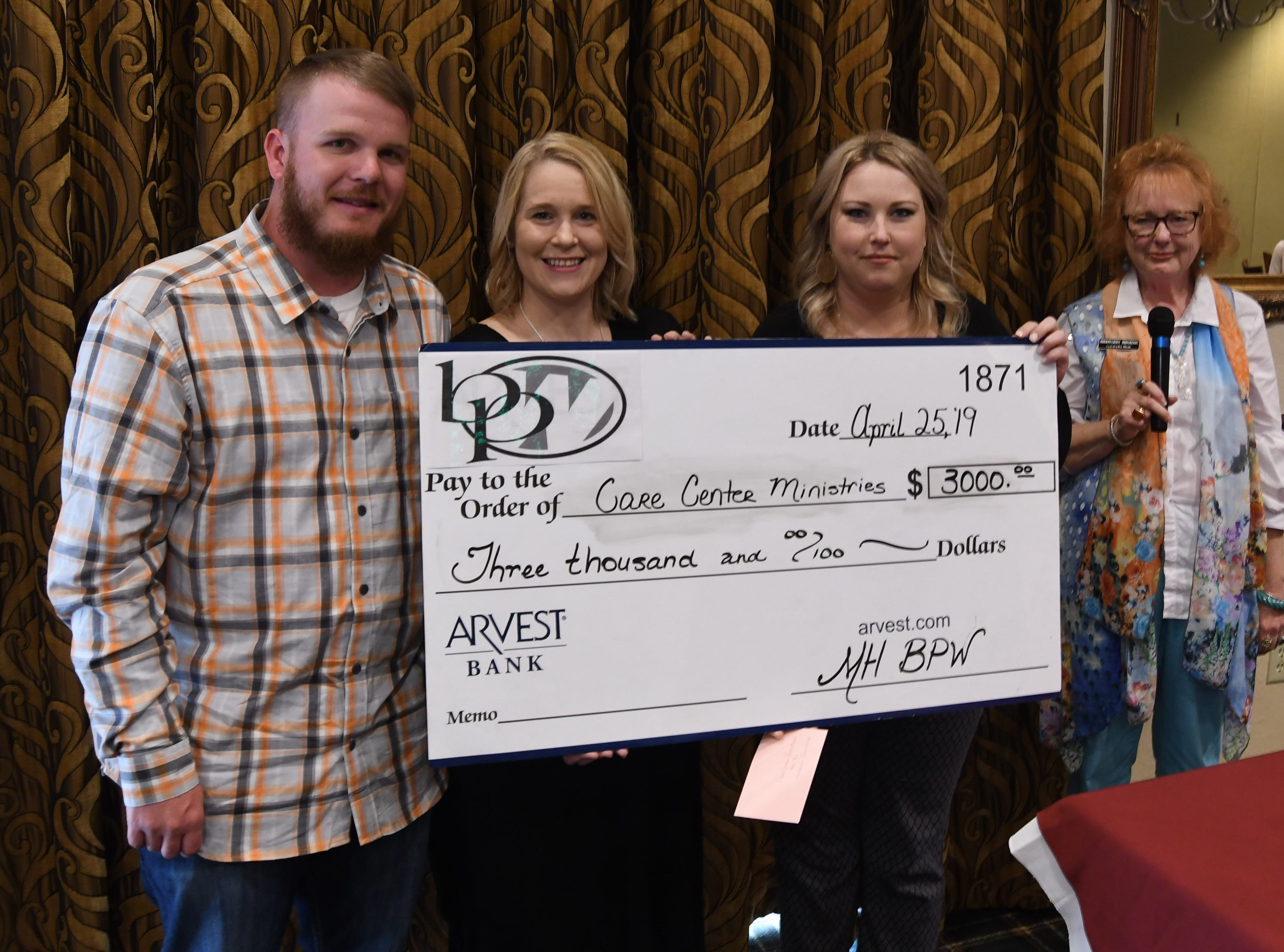 Blake Atchison and Lacy Hampton (left) accept a check for $3,000 from Mountain Home Business & Professional Women president Ashley Hambelton and vice president Lucinda Blair on behalf of Care Center Ministries.