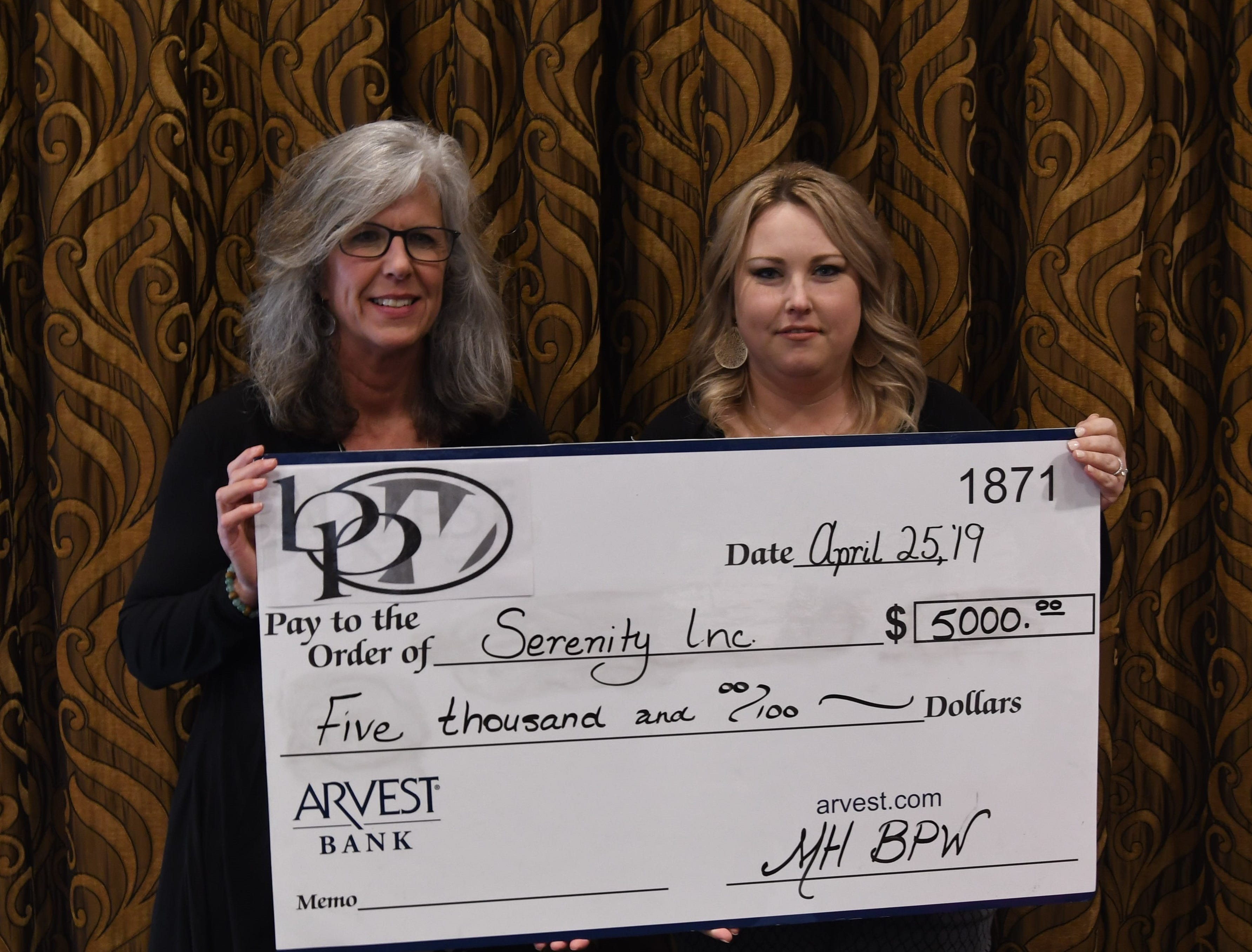 Donna Forrester (left) accepts a check for $5,000 from Mountain Home Business & Professional Women president Ashley Hambelton on behalf of Serenity Inc.