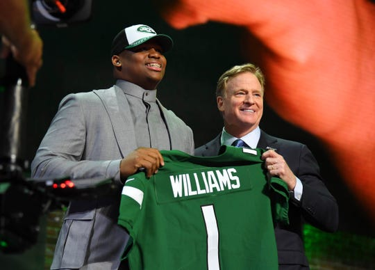 Apr 25, 2019; Nashville, TN, USA; Quinnen Williams (Alabama) stands with NFL commissioner Roger Goodell after he was selected as the number three overall pick to the New York Jets in the first round of the 2019 NFL Draft in Downtown Nashville. Mandatory Credit: Christopher Hanewinckel-USA TODAY Sports