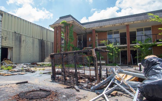 Burned remnants of furniture sit in the parking lot of the Governor's House Hotel after a two-alarm fire had Montgomery firefighters working several hours the night before.