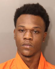 Shawndricaus Townsend was charged with assault and discharging a firearm into an occupied vehicle.