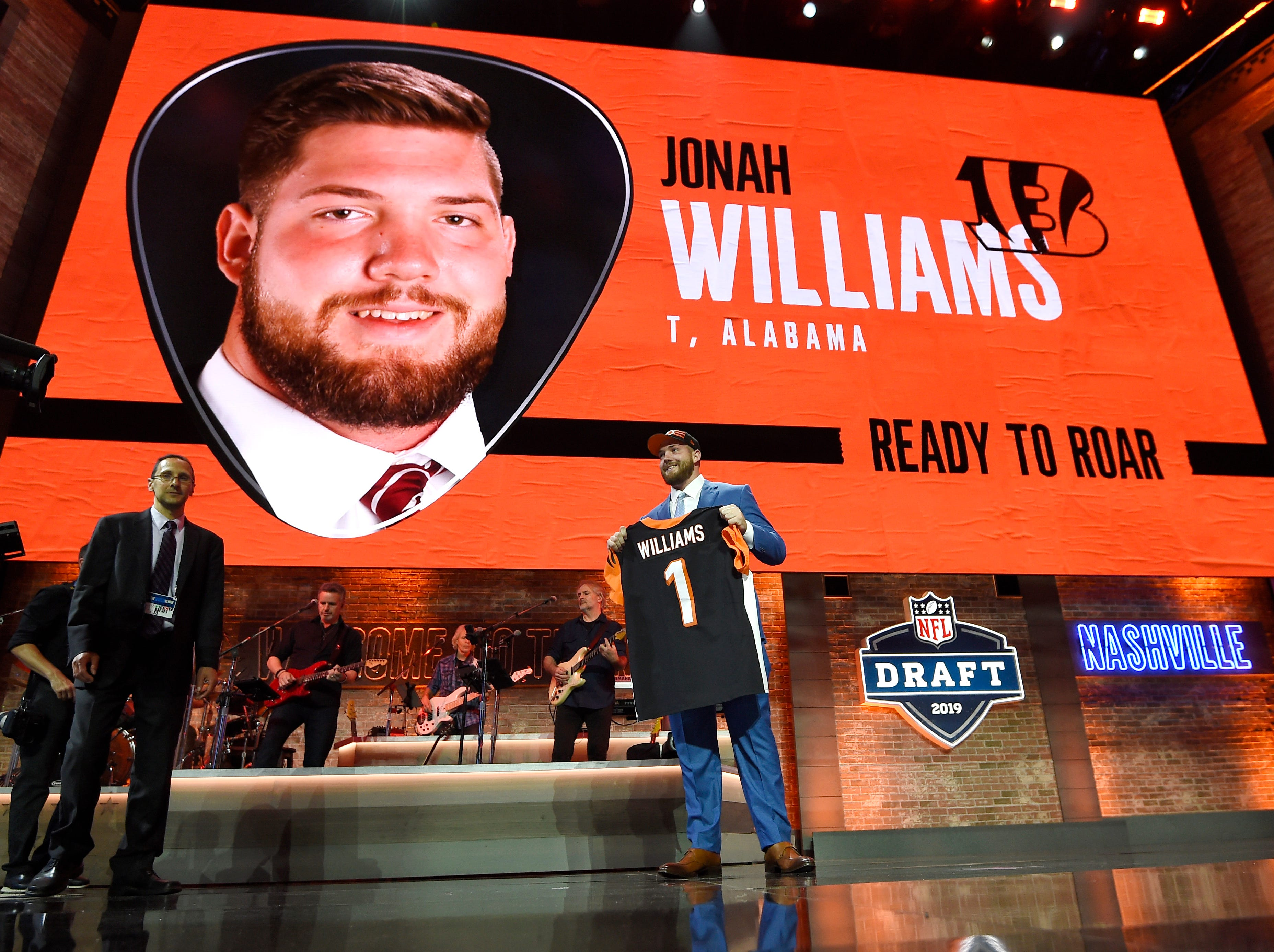 Jonah Williams holds his new Cincinnati Bengals jersey during the first round of the NFL Draft Thursday, April 25, 2019, in Nashville, Tenn.