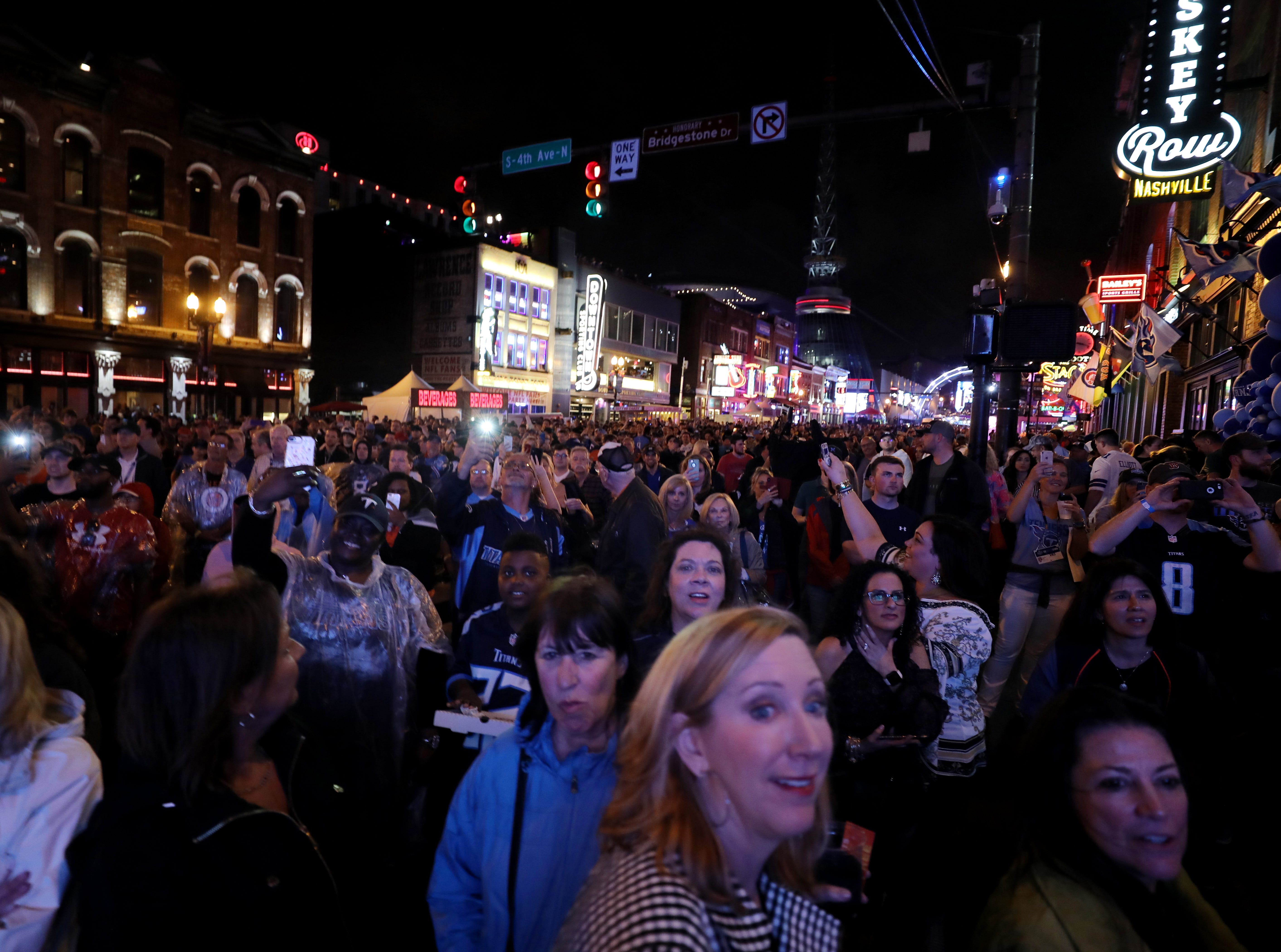 People fill Lower Broadway during the NFL Draft Thursday, April 25, 2019.