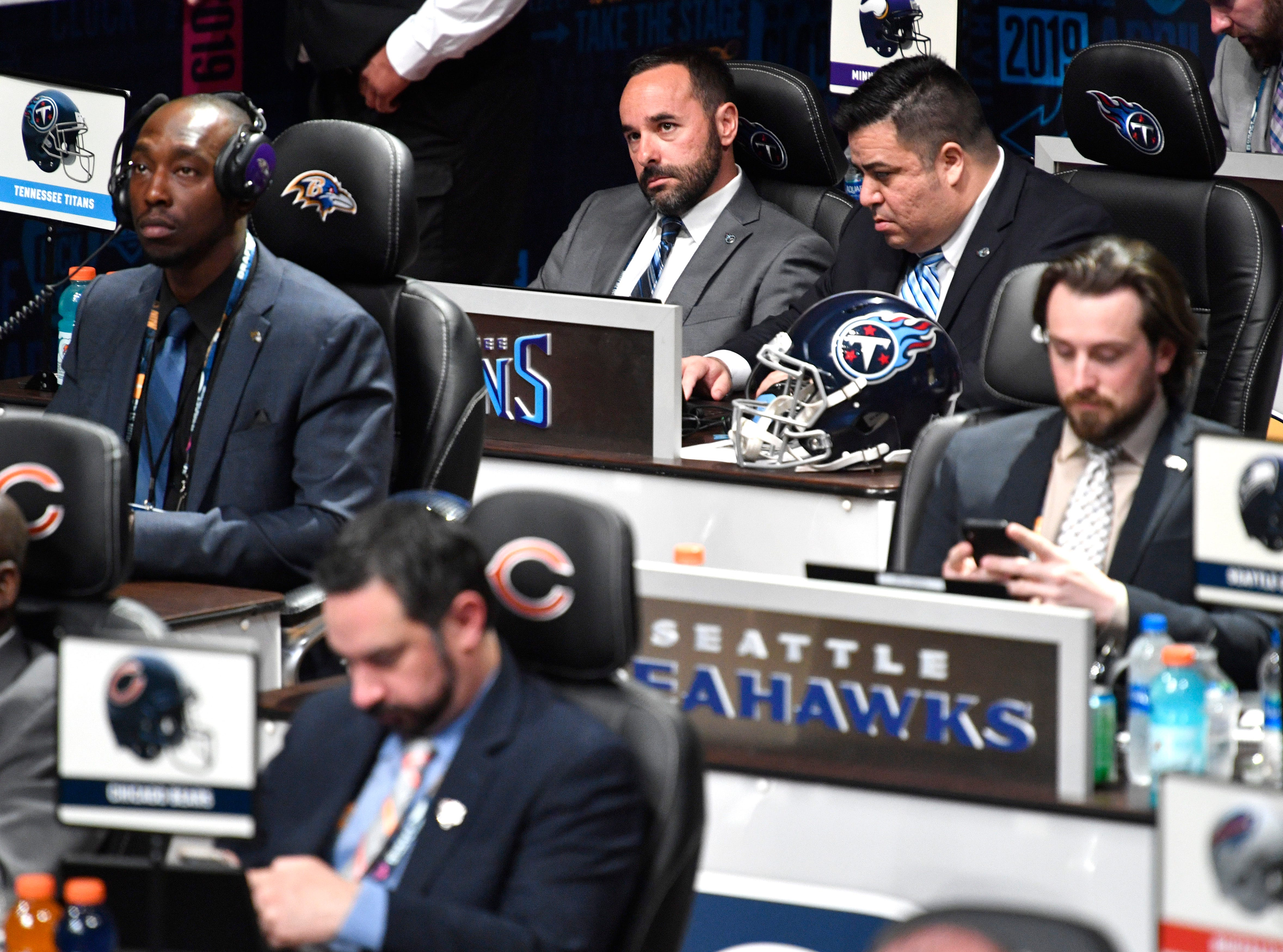 Titans personnel Joey Barranco, left, and Anthony Pastrana wait to make the team's pick in the first round of the NFL Draft Thursday, April 25, 2019, in Nashville, Tenn.