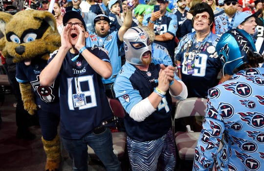 Titans fans celebrates the team's pick of Mississippi State's Jeffery Simmons during the first round of the NFL Draft Thursday, April 25, 2019, in Nashville, Tenn.