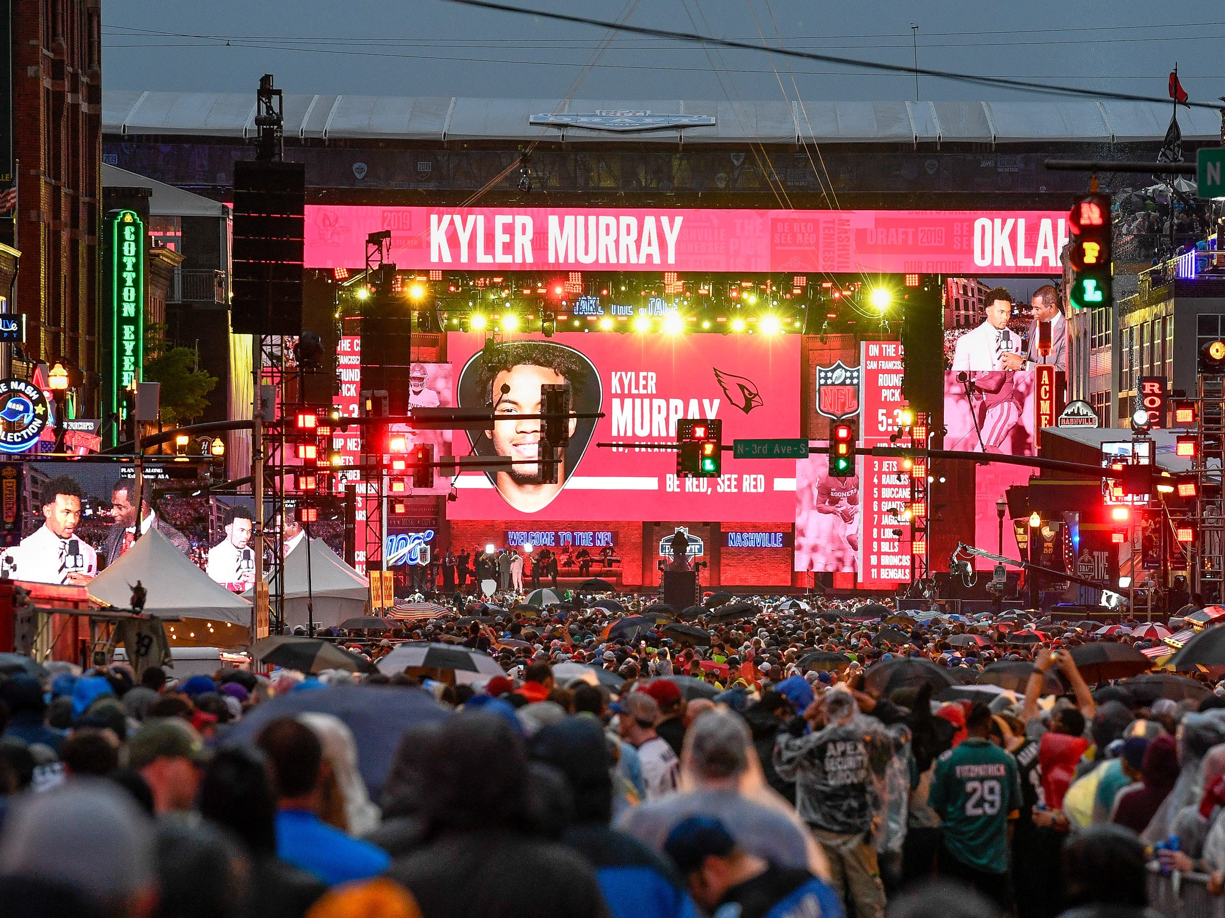 Fans watch as Kyler Murray was selected during the 2019 NFL Draft on Broadway in Nashville, Tenn., Thursday, April 25, 2019.