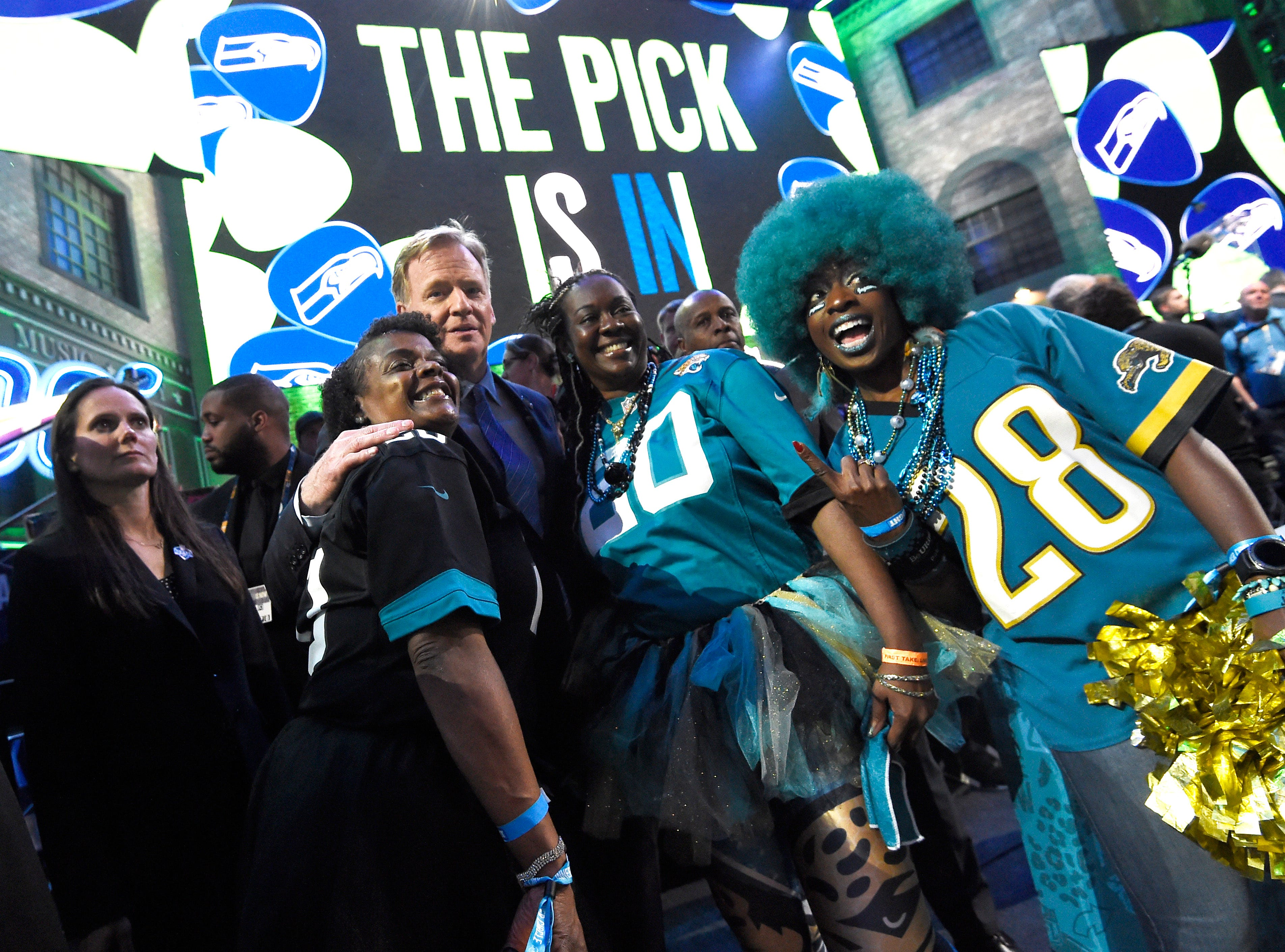 NFL Commisioner Roger Goodell poses with Jaguars fans during the first round of the NFL Draft Thursday, April 25, 2019, in Nashville, Tenn.