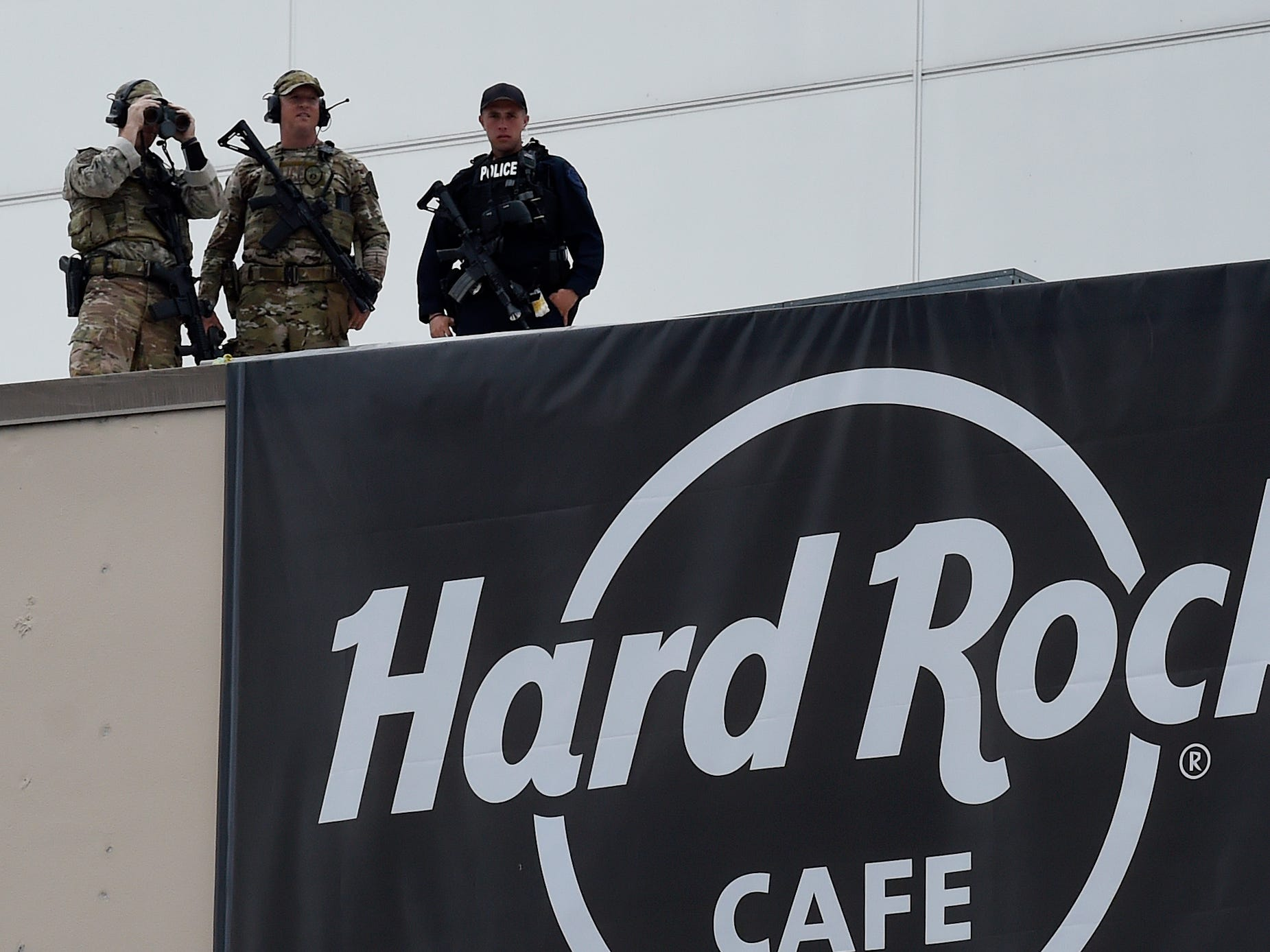 Nashville Metro police and SWAT officers watch from the Hard Rock Cafe during the NFL Draft on Thursday, April 25, 2019, in Nashville, Tenn.