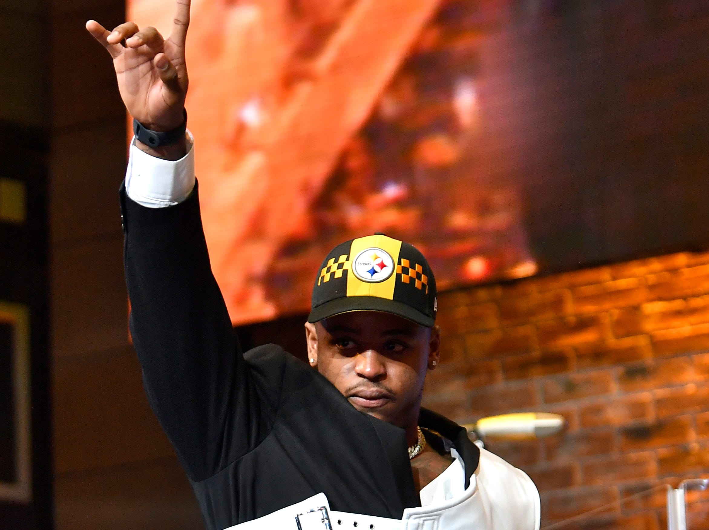 Devin Bush celebrates his pick by the Buffalo Bills during the first round of the NFL Draft Thursday, April 25, 2019, in Nashville, Tenn.