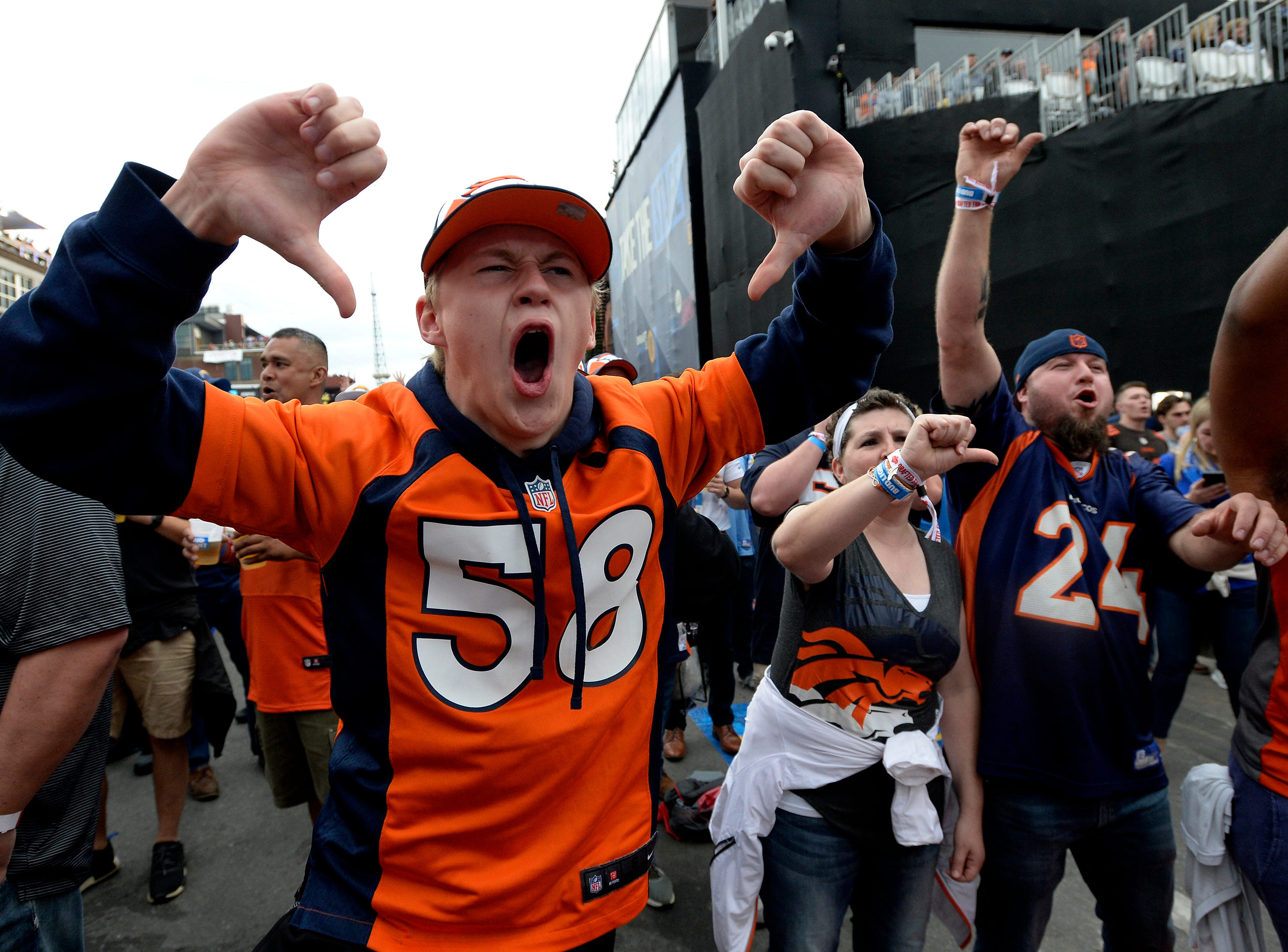 Denver Broncos fan Nick Gashler reacts after the Los Angeles Chargers fans were introduced during the NFL Draft on Thursday, April 25, 2019, in Nashville, Tenn.
