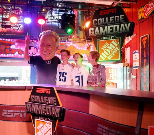 Tom Dejarnette wears a giant Tom Corso mask for a photo with his wife Sue and grandsons Gage Wilson and Brewer Wilson during ESPN party for the NFL draft at Tin Roof on Lower Broadway Thursday, April 25, 2019.
