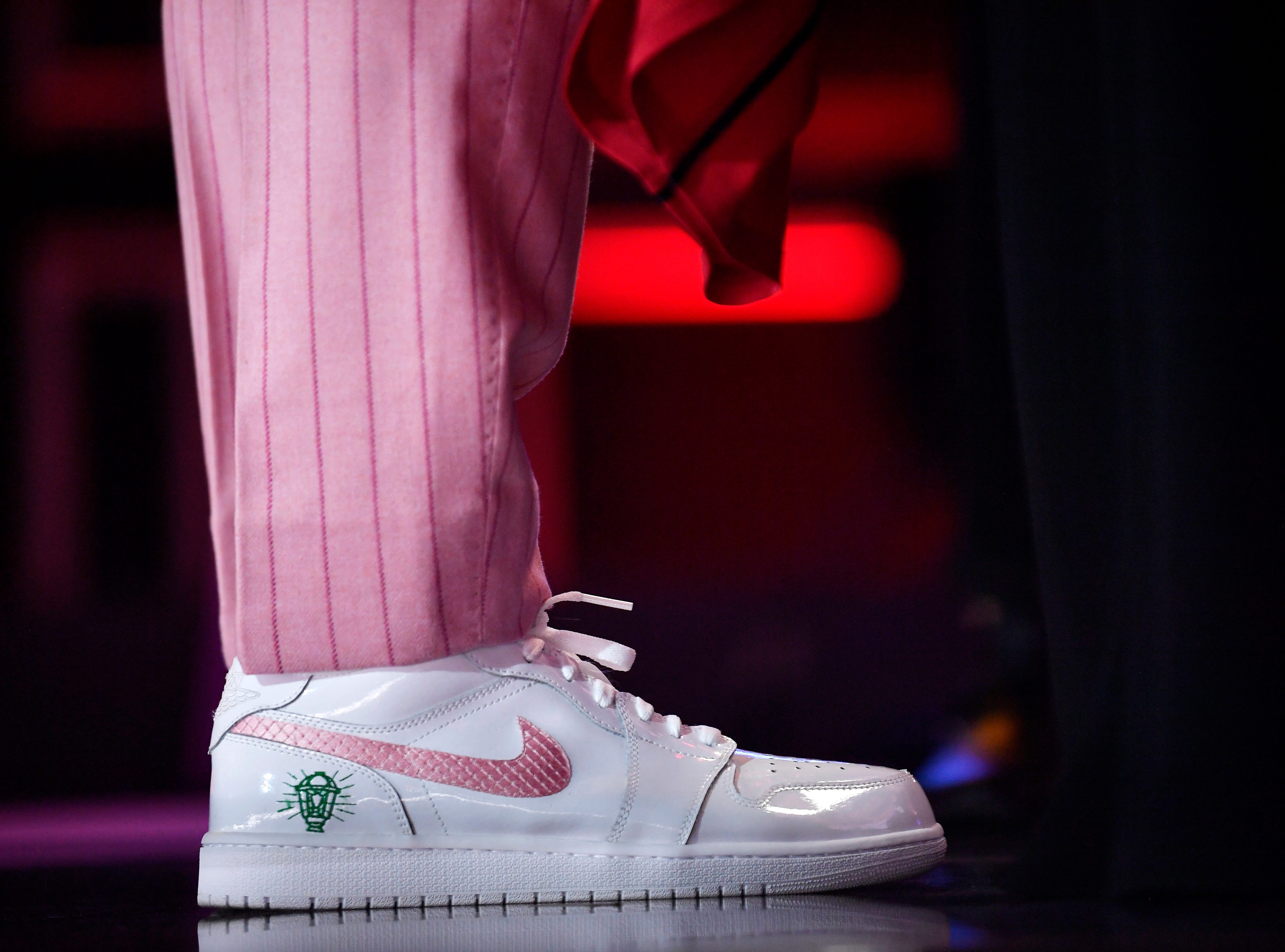 Kyler Murray wears tennis shoes with his suit as he picked first by the Arizona Cardinals in the first round of the NFL Draft Thursday, April 25, 2019, in Nashville, Tenn.