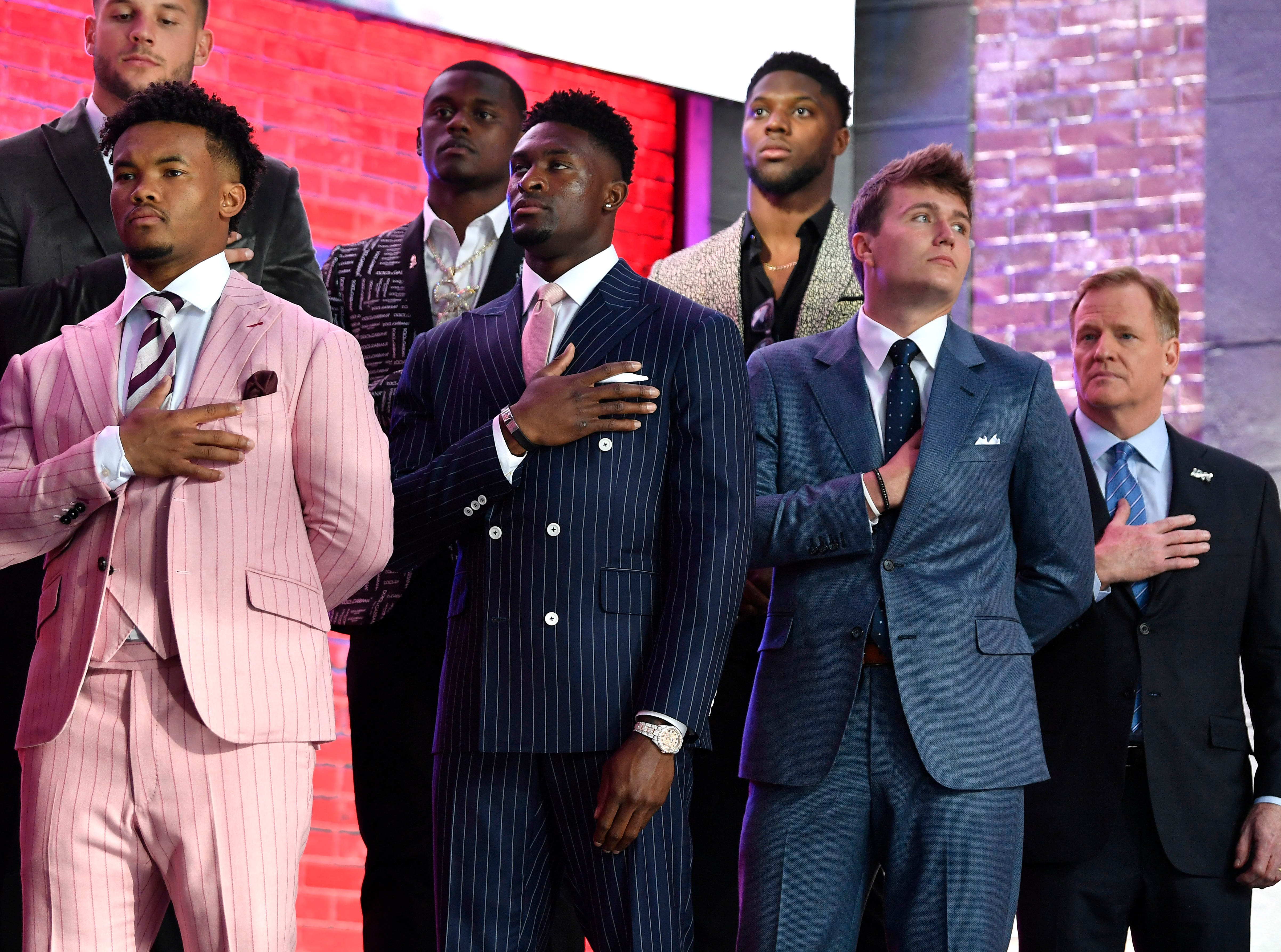 NFL Commissioner Roger Goodell and some of the draft prospects listen to the National Anthem at the start of the NFL Draft Thursday, April 25, 2019, in Nashville, Tenn.
