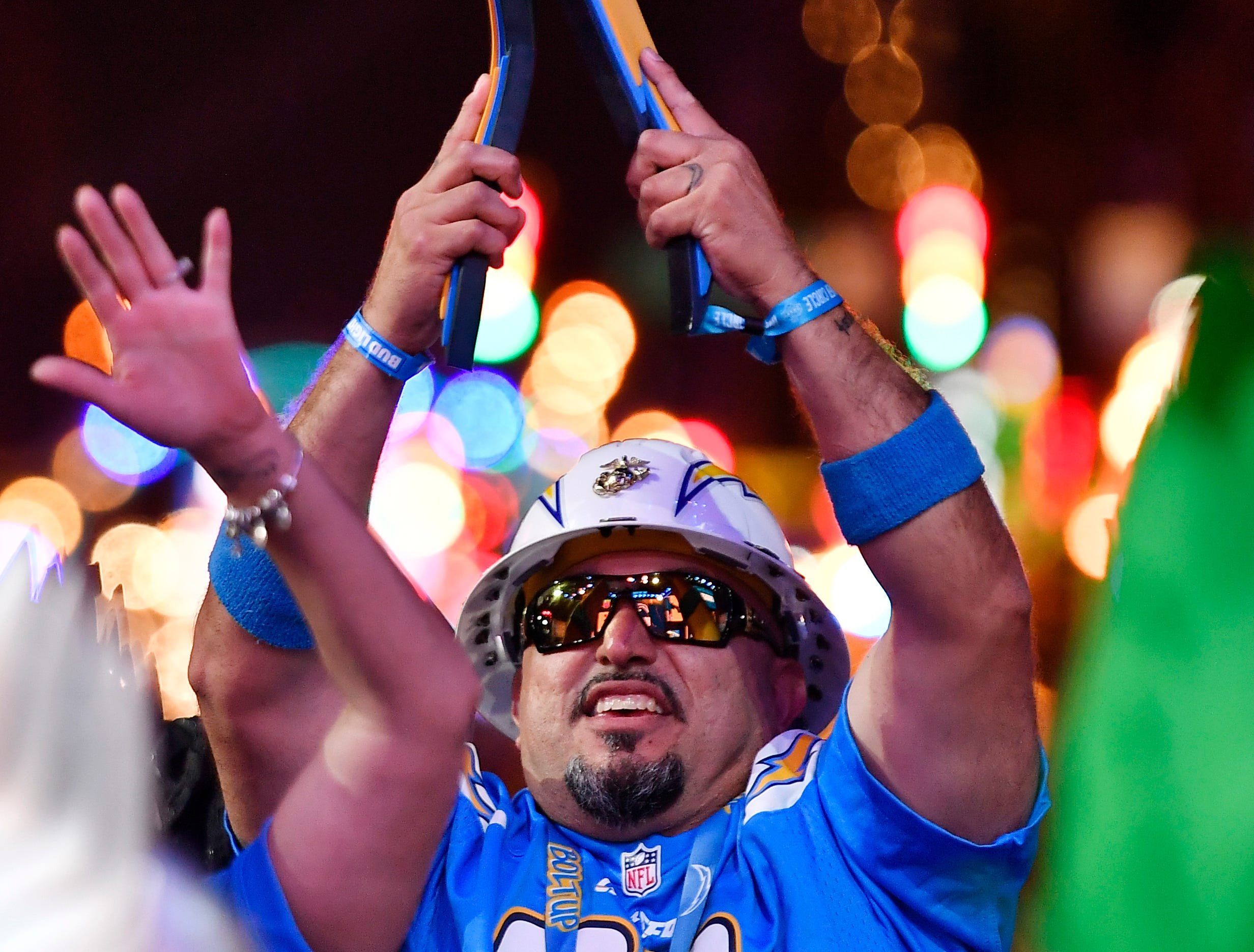 An Los Angeles Chargers fan cheers during the first round of the NFL Draft Thursday, April 25, 2019, in Nashville, Tenn.