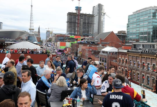 People gather on the rooftop of Kid Rock's honky-tonk for the Pinnacle Financial Partners NFL Draft party Thursday, April 25, 2019.