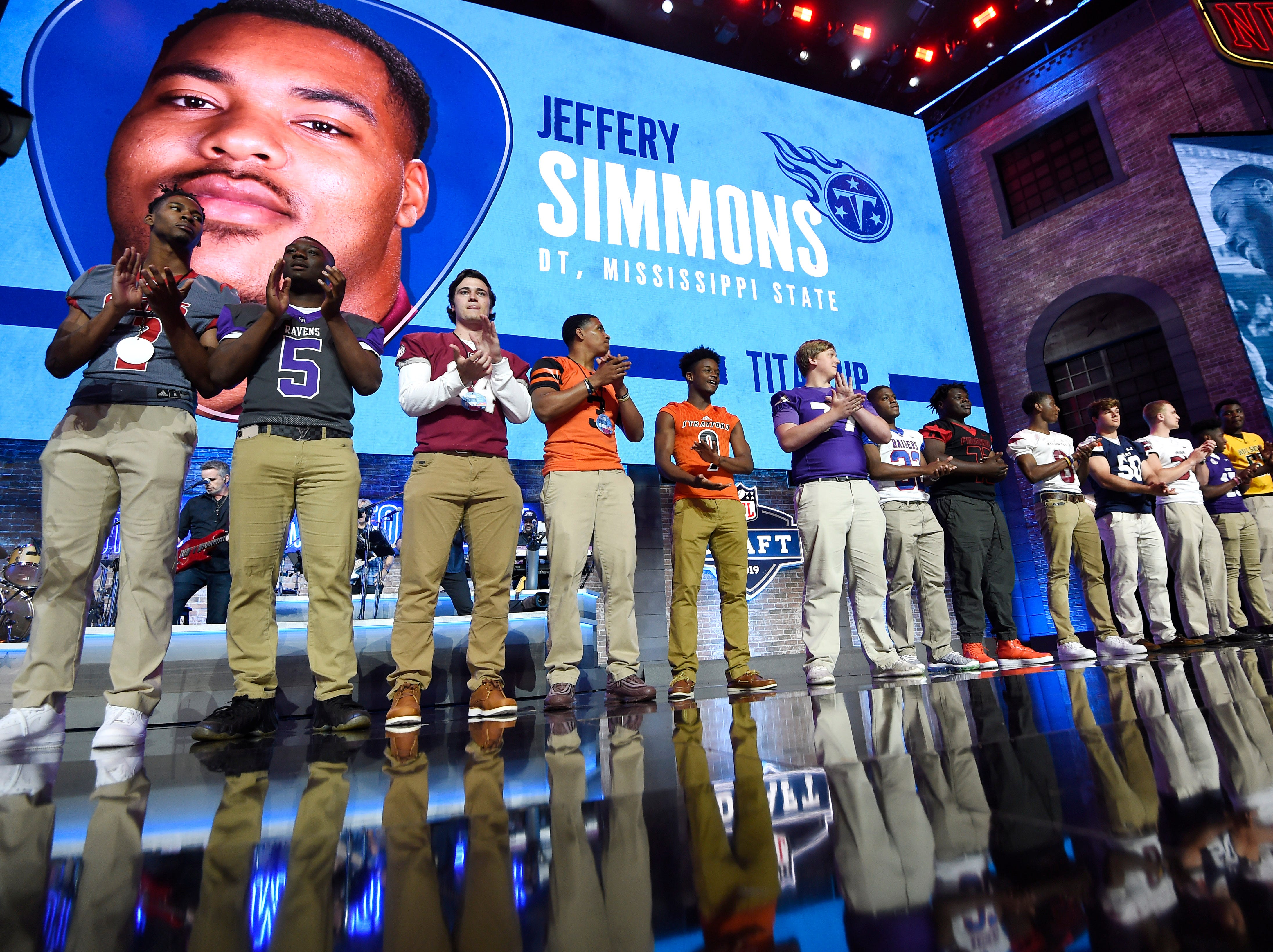 TSSAA athletes applaud the Titans' pick of Mississippi State's Jeffery Simmons during the first round of the NFL Draft Thursday, April 25, 2019, in Nashville, Tenn.