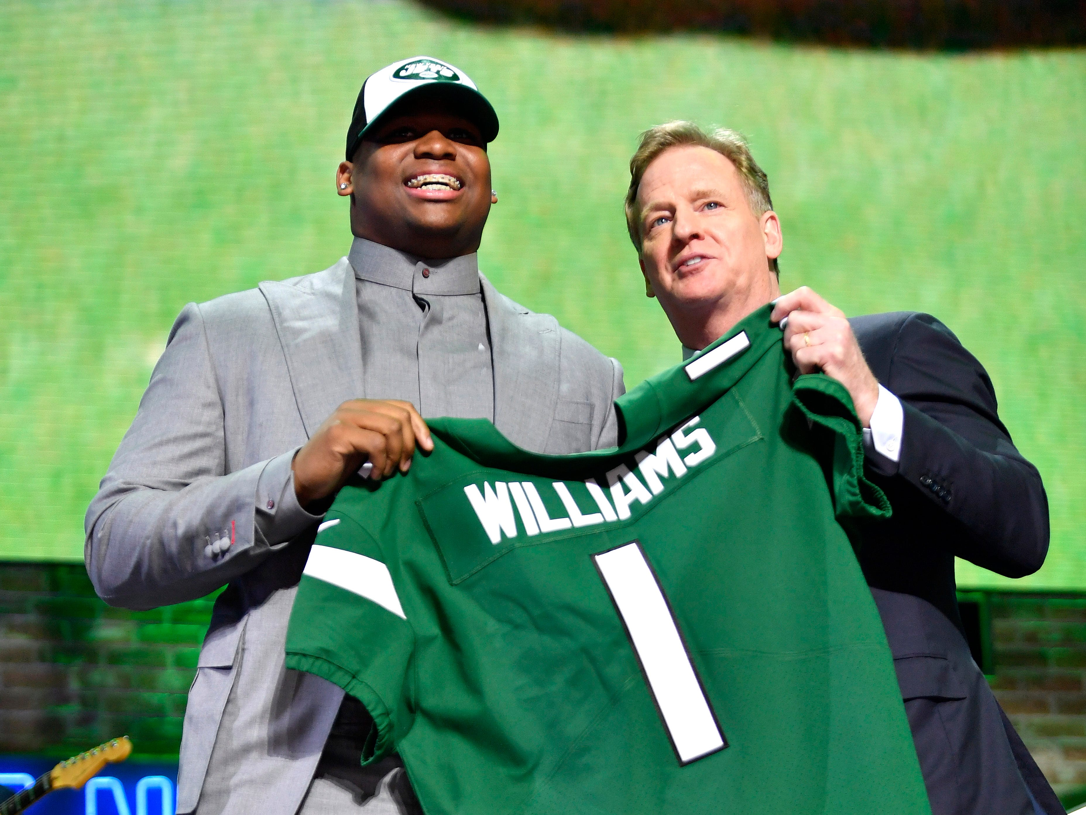 Quinnen WIlliams poses with his new Jets jersey and NFL Commissioner Roger Goodell during the first round of the NFL Draft Thursday, April 25, 2019, in Nashville, Tenn.