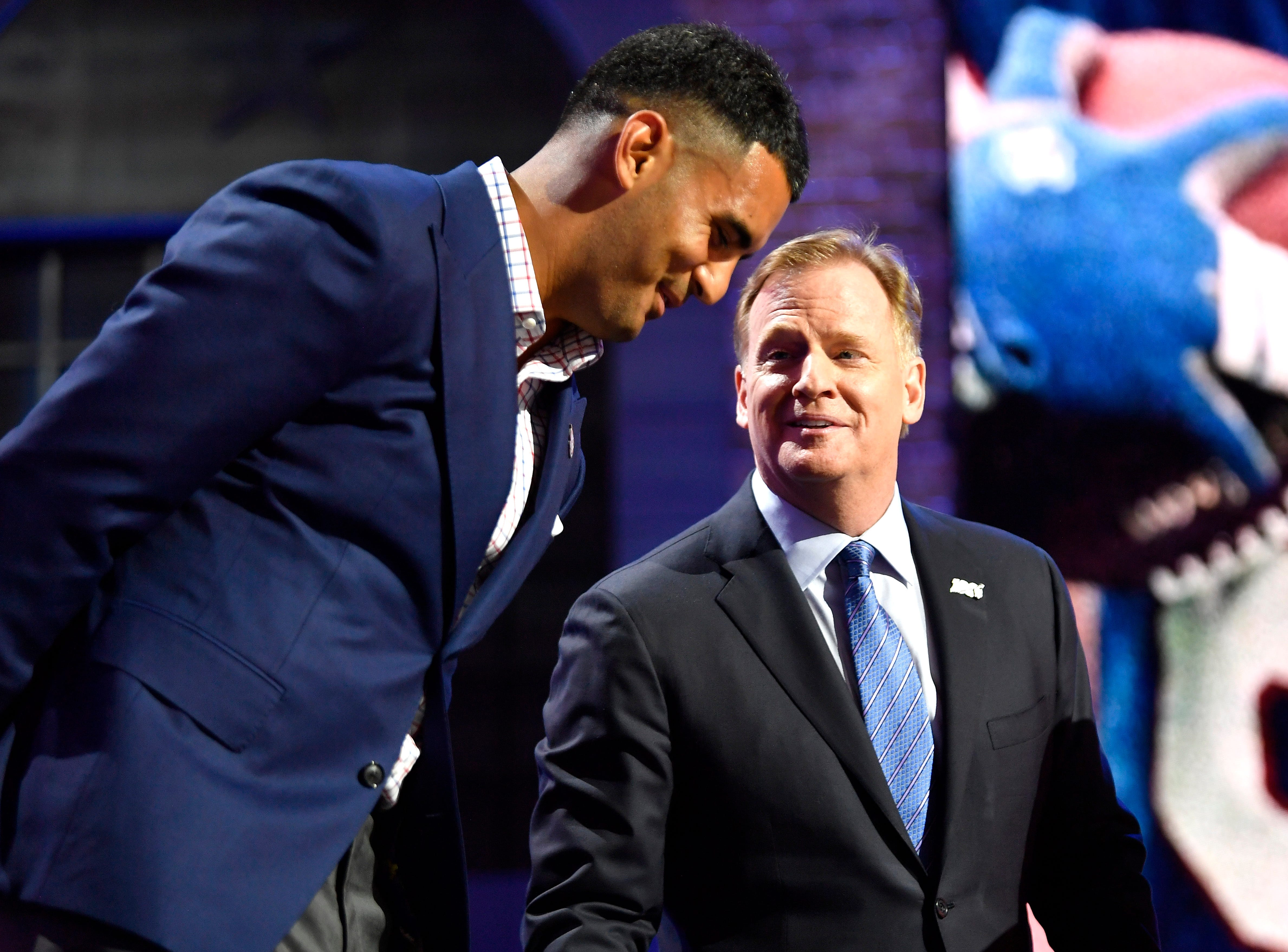 Titans quarterback Marcus Mariota stands on stage with NFL Commissioner Roger Goodell during the first round of the NFL Draft Thursday, April 25, 2019, in Nashville, Tenn.
