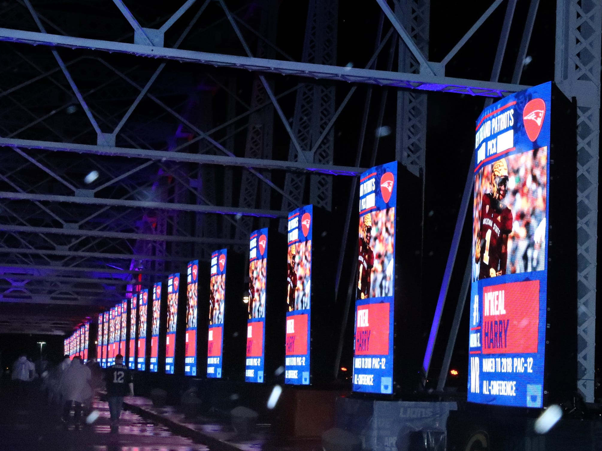 An image of N'Keal Harry pops up on screens along the  Seigenthaler Bridge, in Nashville, Tennessee, after he was selected as the last player in the first round of the NFL Draft on Thursday, April 25, 2019, in Nashville, Tennessee.