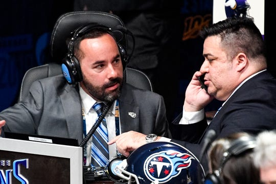 Titans personnel Joey Barranco, left, and Anthony Pastrana wait to make the team's pick in the first round of the NFL Draft at the Schermerhorn Symphony Center on Thursday, April 25, 2019.
