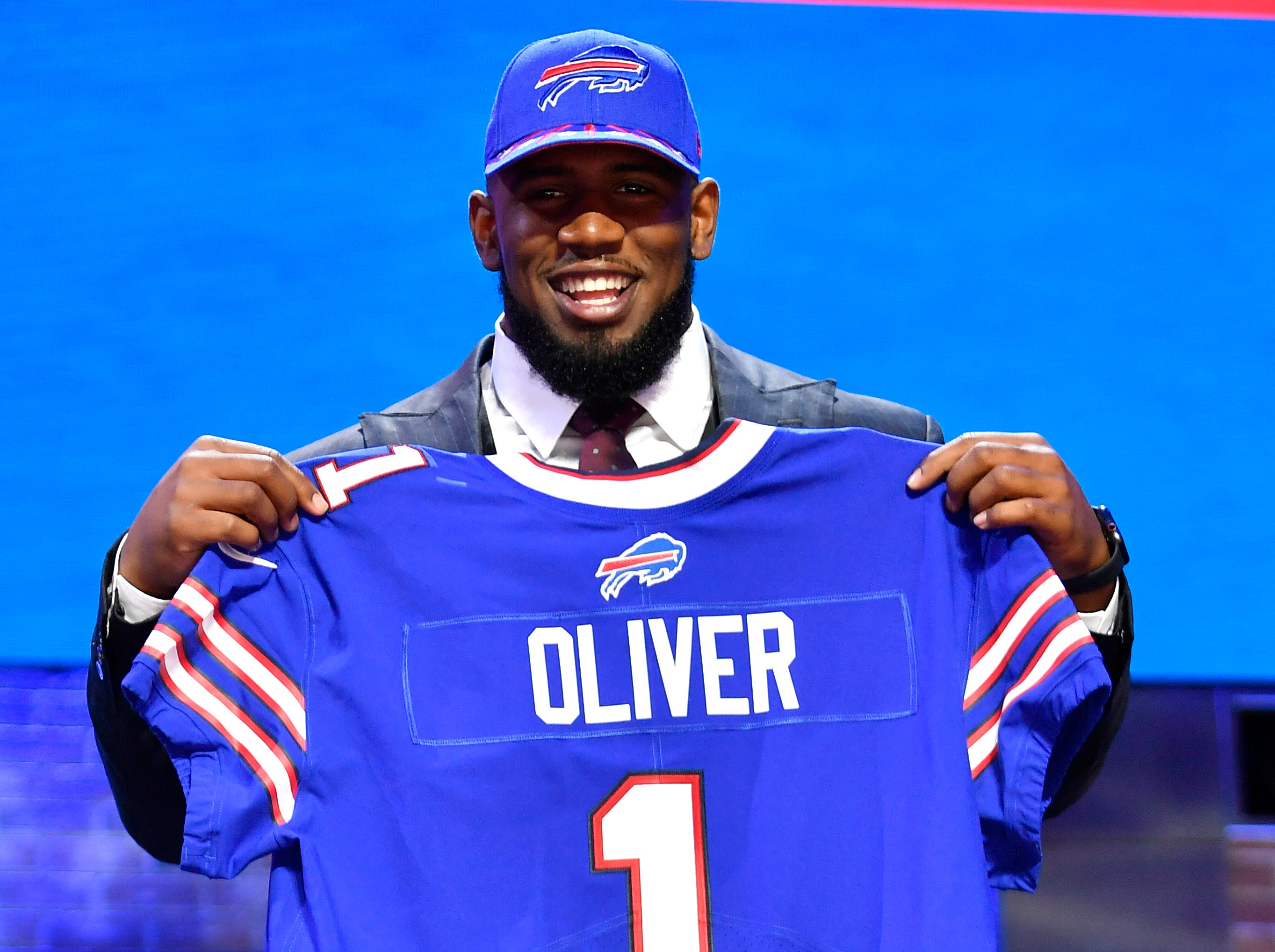 Ed Oliver holds his new Buffalo Bills jersey after being picked during the first round of the NFL Draft Thursday, April 25, 2019, in Nashville, Tenn.