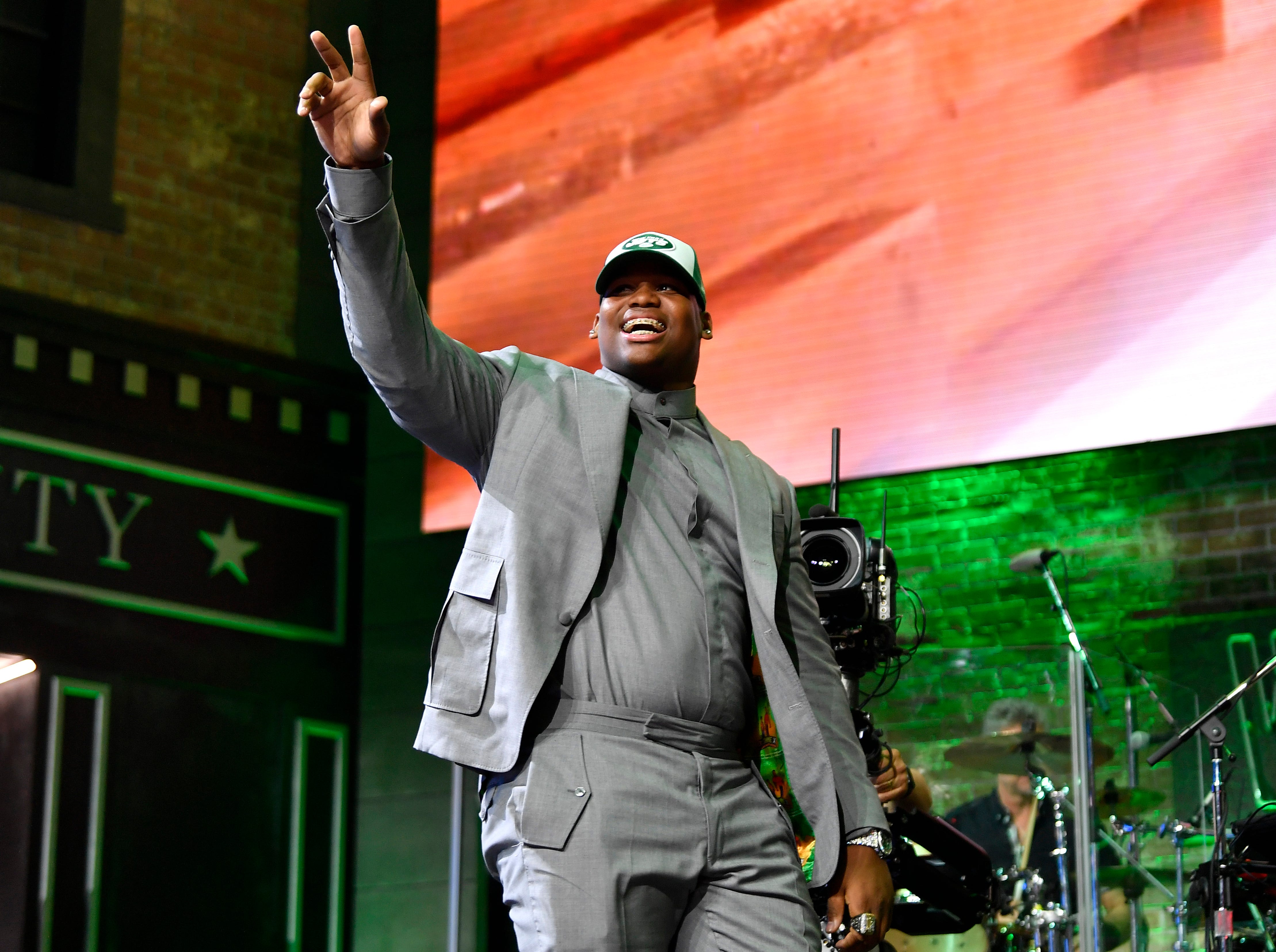 Quinnen Williams waves to the crowd after being selected by the New York Jets during the first round of the NFL Draft Thursday, April 25, 2019, in Nashville, Tenn.