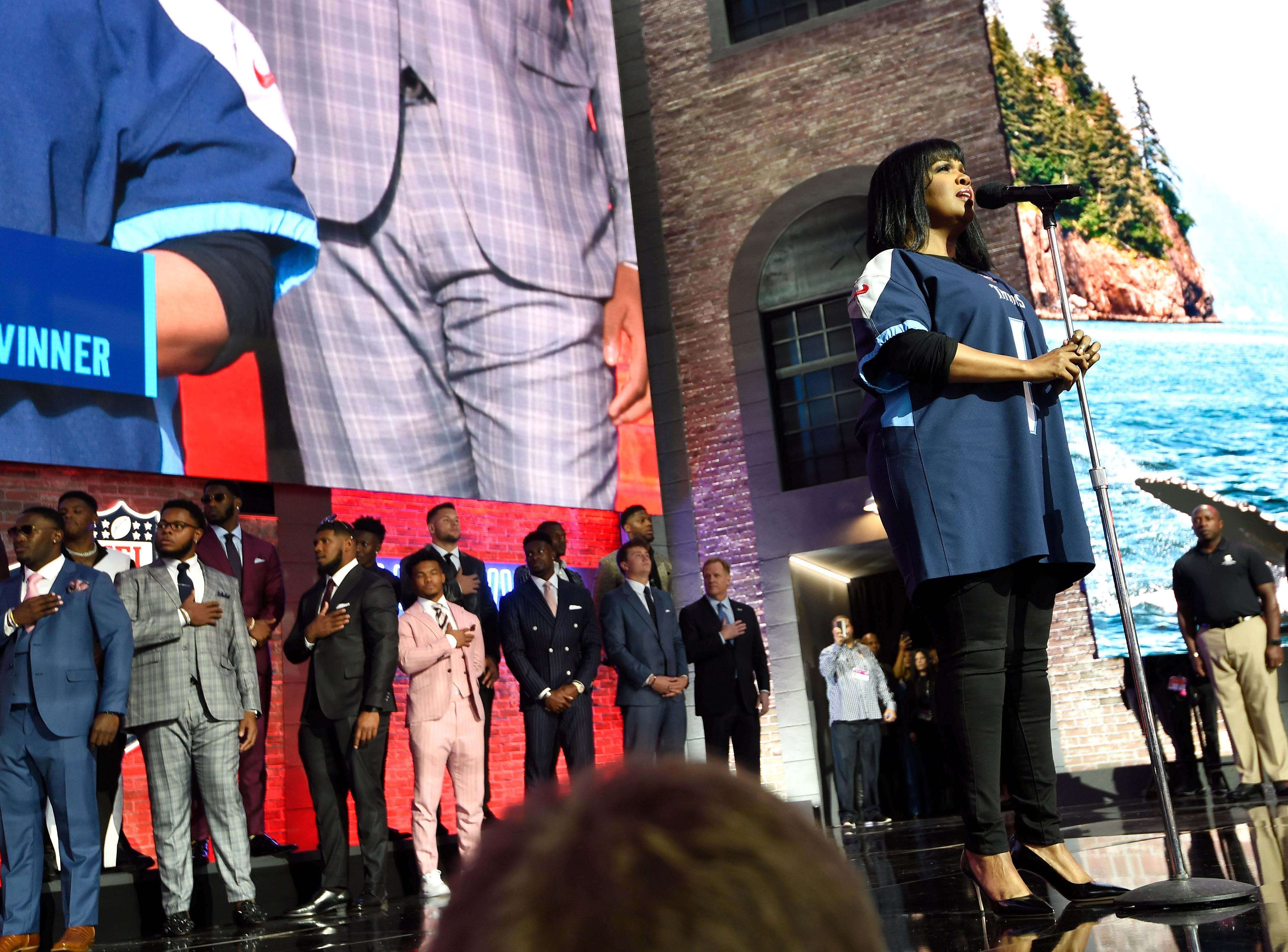 CeCe Winans sings the National Anthem in front of the draft prospects before the first round of the NFL Draft Thursday, April 25, 2019, in Nashville, Tenn.