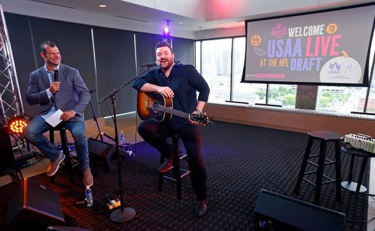 Country music star Chris Young, right, and NFL legend Joe Thomas take questions from military service members during USAA's NFL Draft Salute to Service event on April 25, 2019 at The Steps at WME in Nashville.