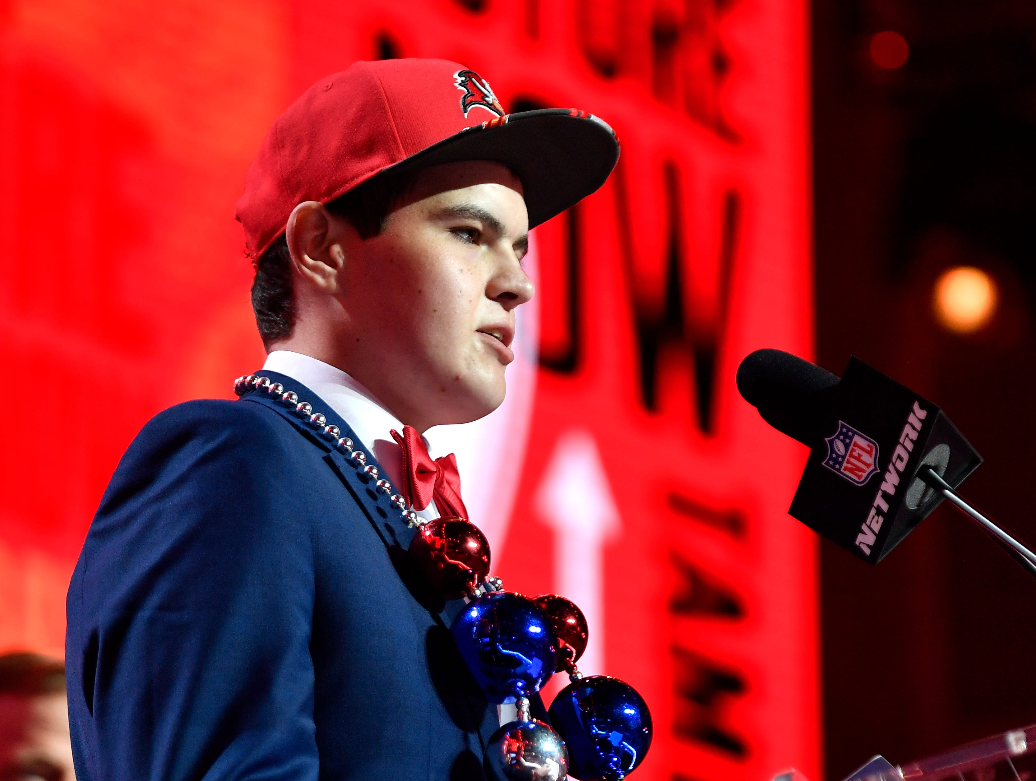A Make-A-Wish participant reads the Tampa Bay Buccaneers' pick during the first round of the NFL Draft Thursday, April 25, 2019, in Nashville, Tenn.