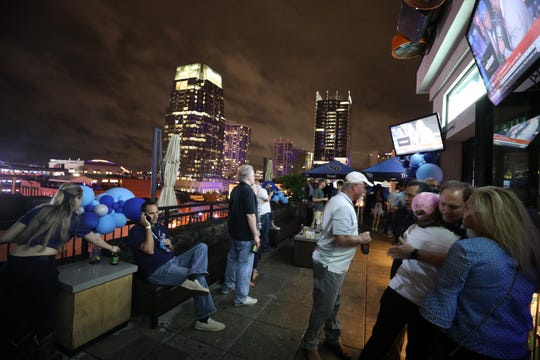 People gather on the rooftop of Whiskey Row for an NFL Draft watch Thursday, April 25, 2019.