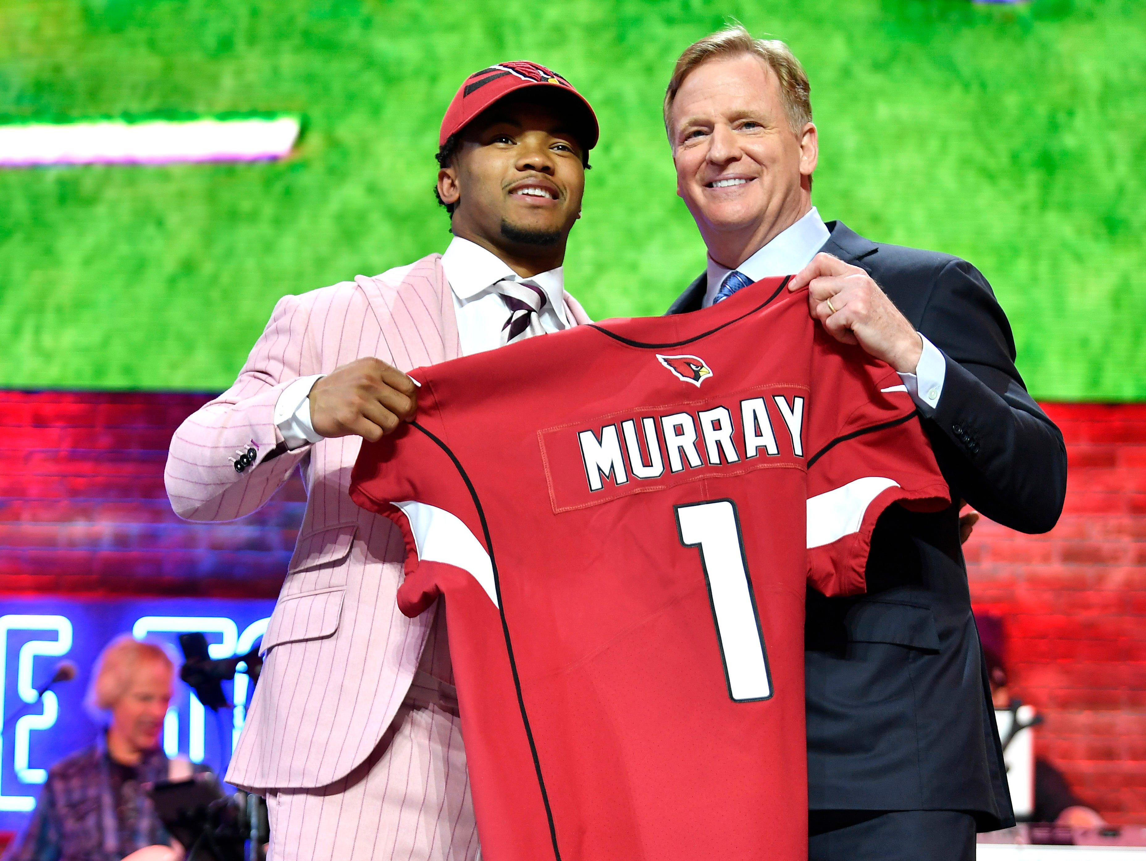 Kyler Murray poses with NFL Commissioner Roger Goodell after being picked first by the Arizona Cardinals during the first round of the NFL Draft Thursday, April 25, 2019, in Nashville, Tenn.