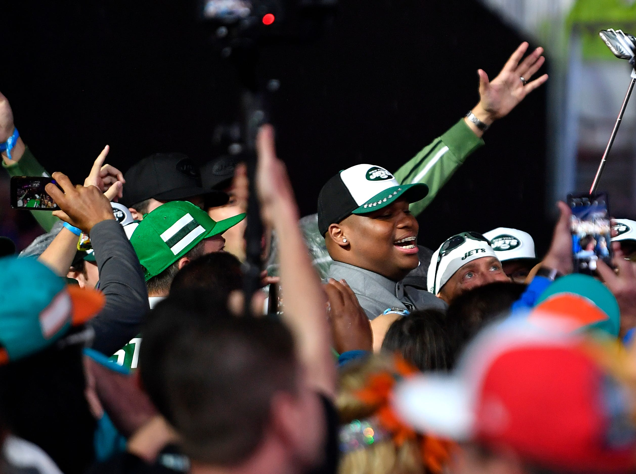 Quinnen WIlliams mingles with New York Jets fans after being picked during the first round of the NFL Draft Thursday, April 25, 2019, in Nashville, Tenn.