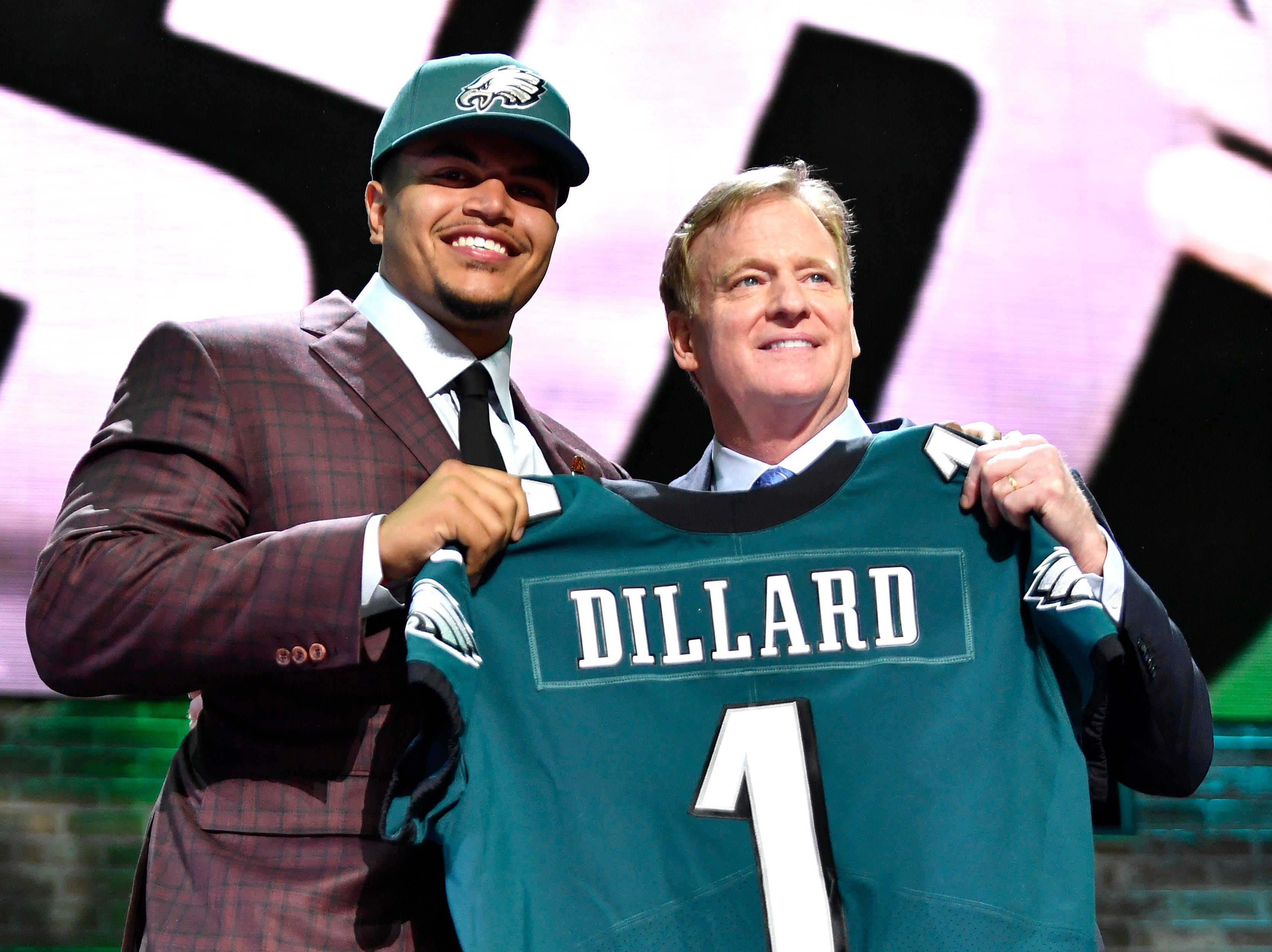 Eagles pick Andre Dillard holds his jersey with NFL Commissioner Roger Goodell during the first round of the NFL Draft Thursday, April 25, 2019, in Nashville, Tenn.