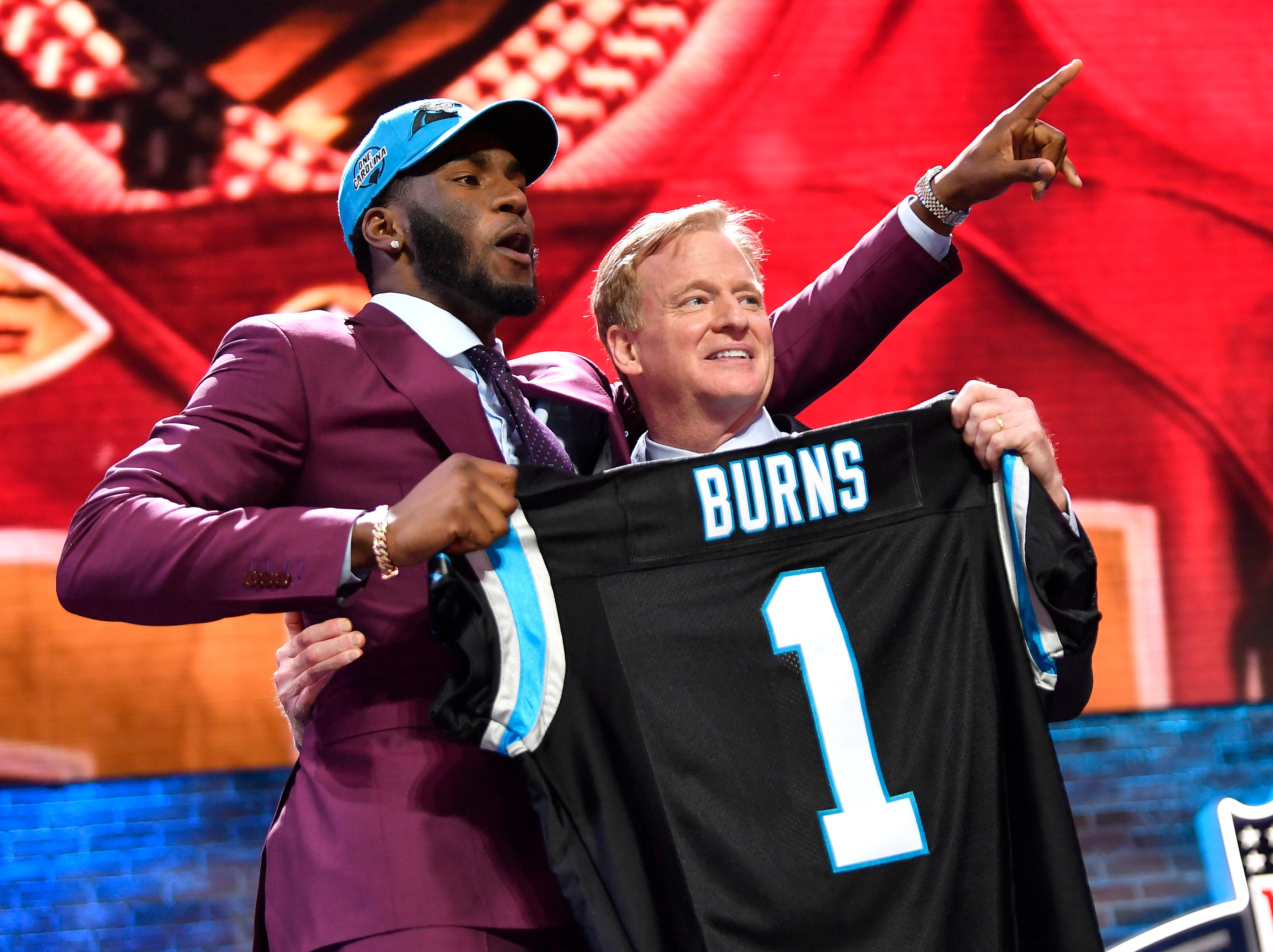 Brian Burns celebrates his pick by the Carolina Panthers with NFL Commissioner Roger Goodell during the first round of the NFL Draft Thursday, April 25, 2019, in Nashville, Tenn.