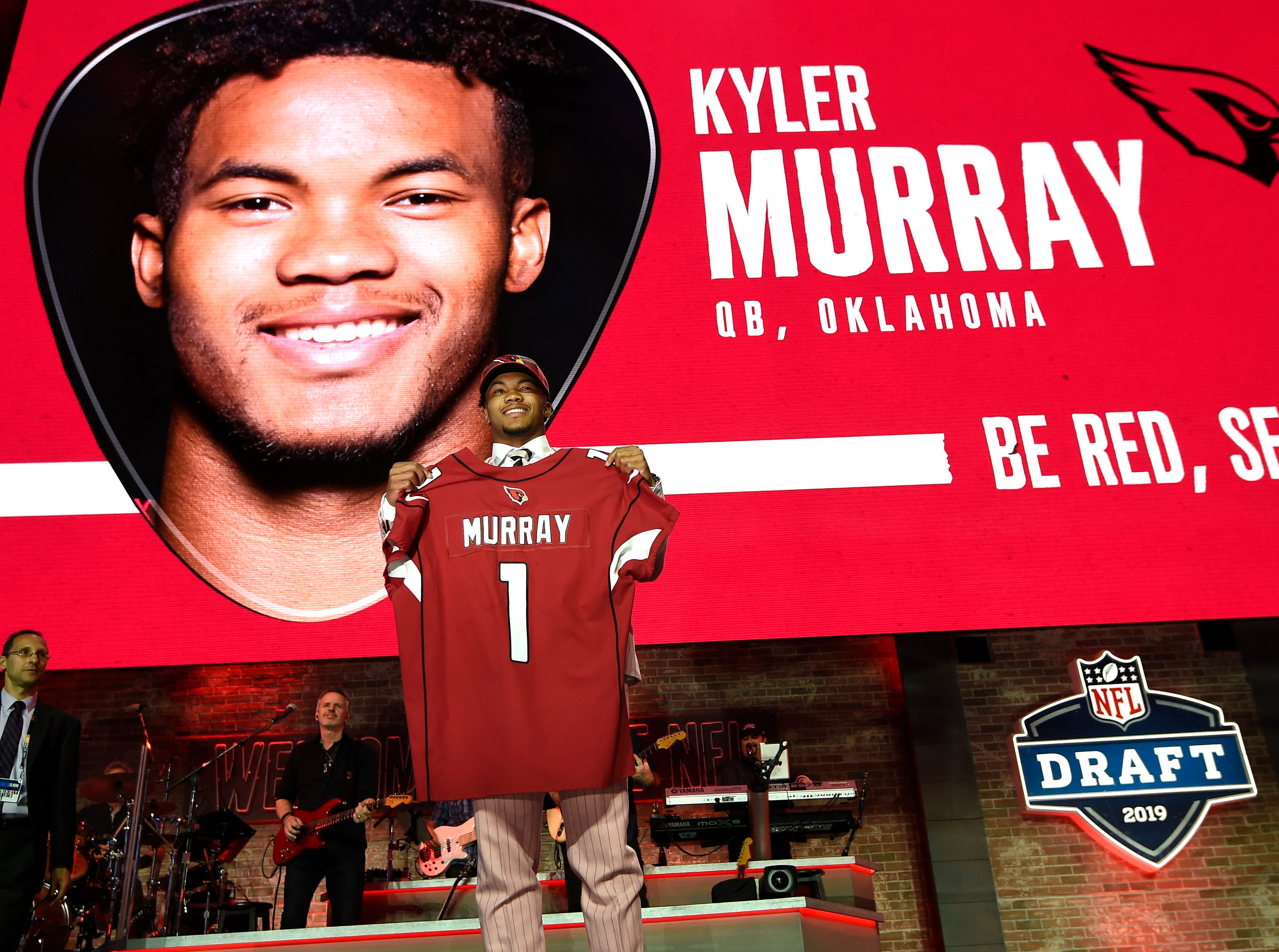 Kyler Murray poses with his new jersey after being picked first by the Arizona Cardinals during the first round of the NFL Draft Thursday, April 25, 2019, in Nashville, Tenn.