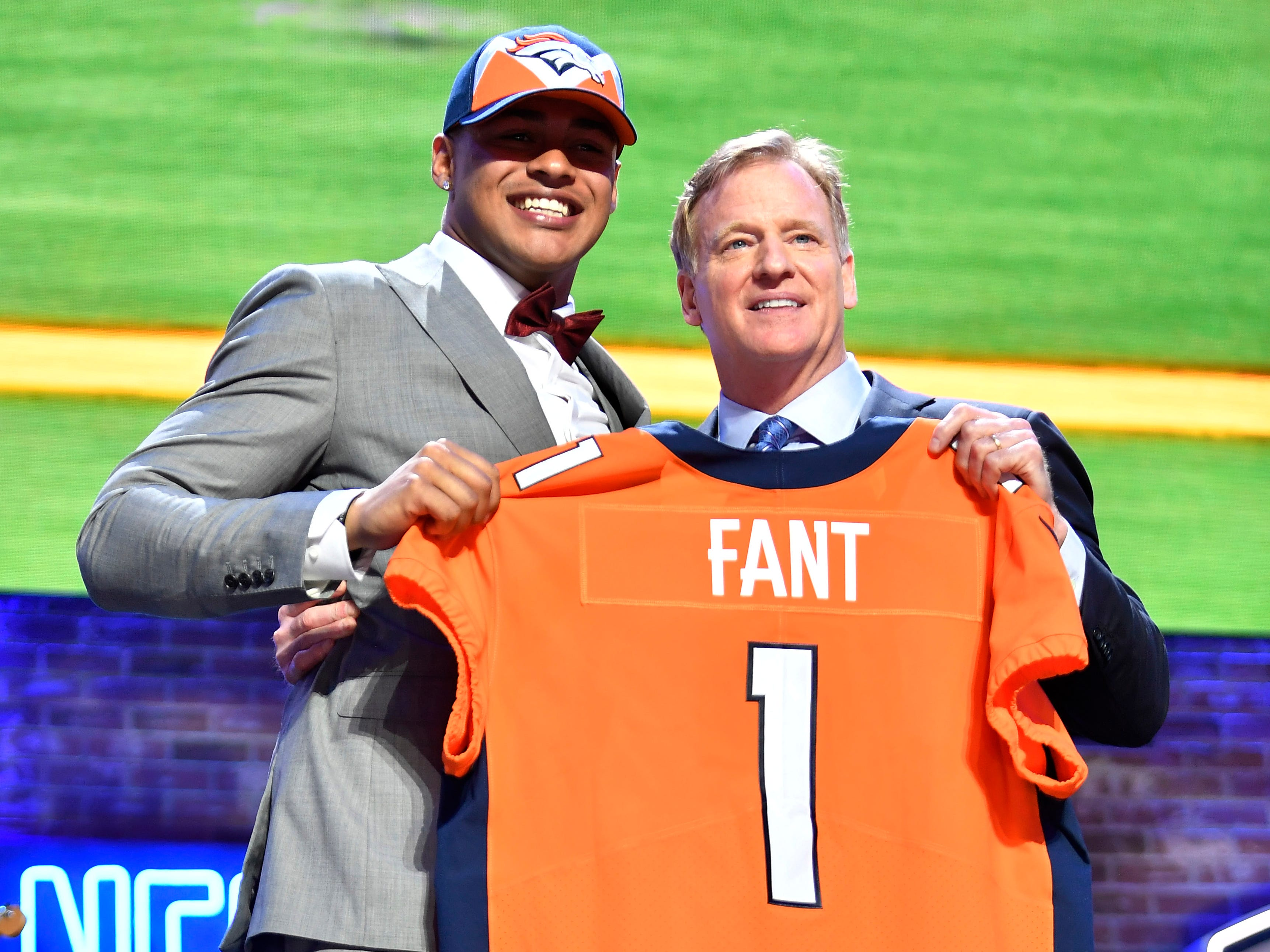 Noah Fant celebrates his pick by the Denver Broncos with NFL Commissioner Roger Goodell during the first round of the NFL Draft Thursday, April 25, 2019, in Nashville, Tenn.