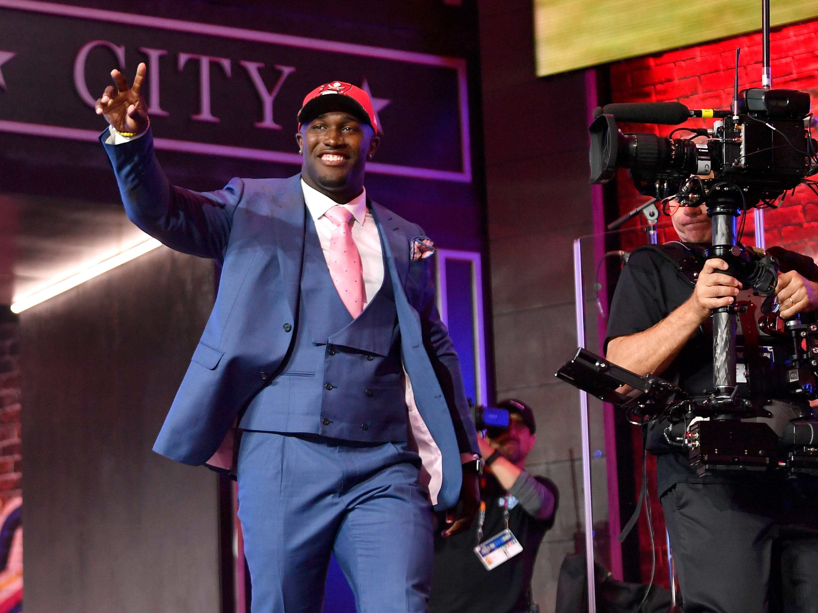 Devin White walks onto the stage after being picked by the Tampa Bay Buccaneers during the first round of the NFL Draft Thursday, April 25, 2019, in Nashville, Tenn.