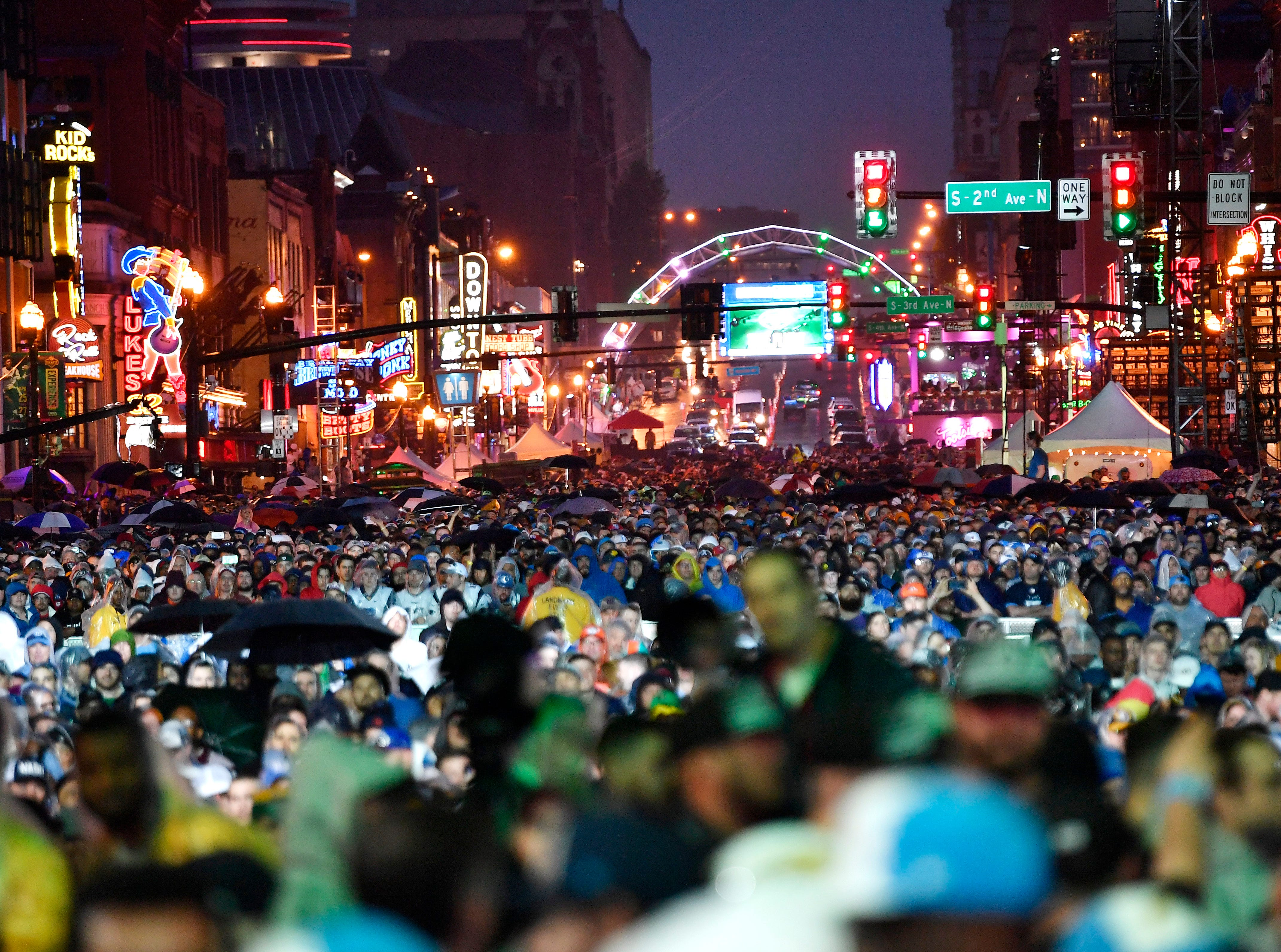 Broadway is packed at the start of the first round of the NFL Draft Thursday, April 25, 2019, in Nashville, Tenn.
