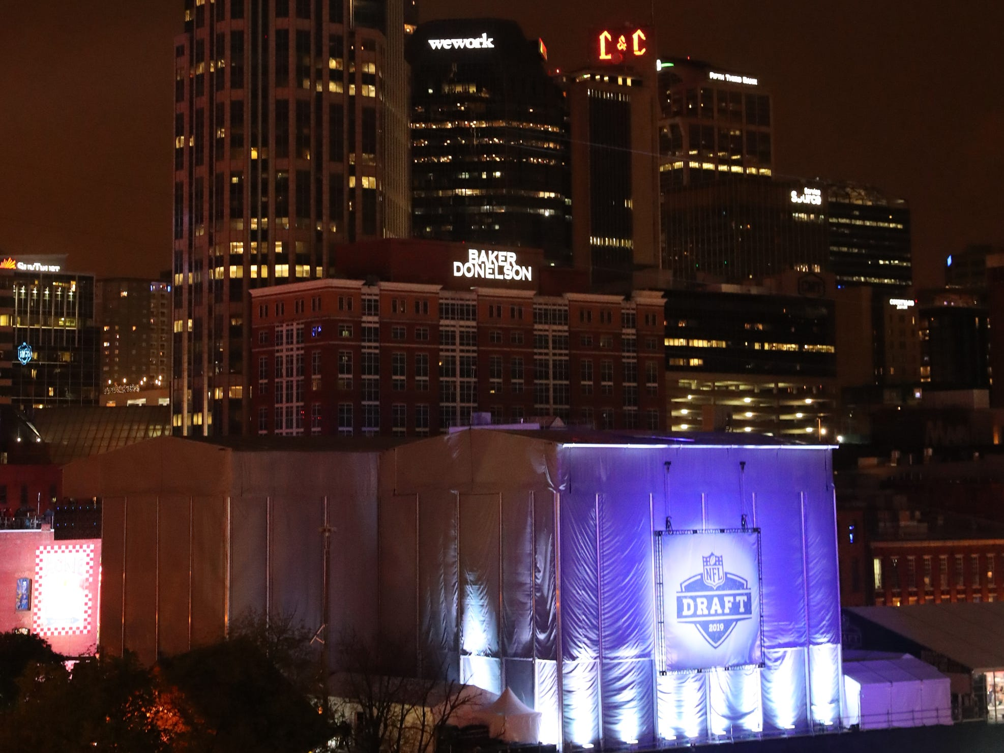 The back of the stage on lower Broadway is lit up with the Draft logo on the first night of the NFL Draft on Thursday, April 25, 2019, in Nashville, Tennessee.