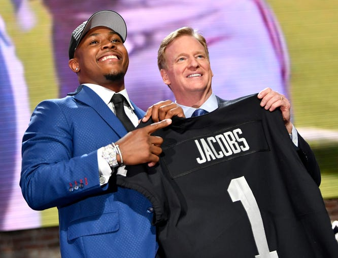 Josh Jacobs poses with his Raiders jersey and NFL Commissioner Roger Goodell after being picked in the first round of the NFL Draft Thursday, April 25, 2019, in Nashville, Tenn.