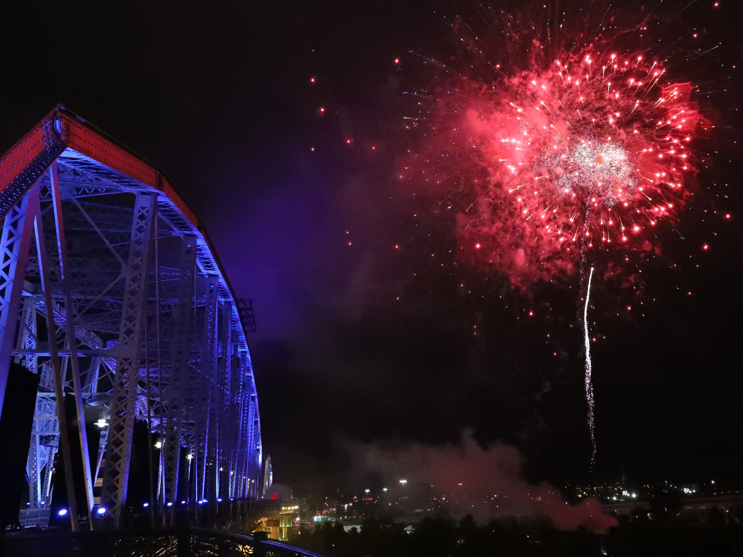Fireworks are set off near the Seigenthaler Bridge and in the Nissan Stadium after the last player was picked in the first round of the NFL Draft on Thursday, April 25, 2019, in Nashville, Tennessee.