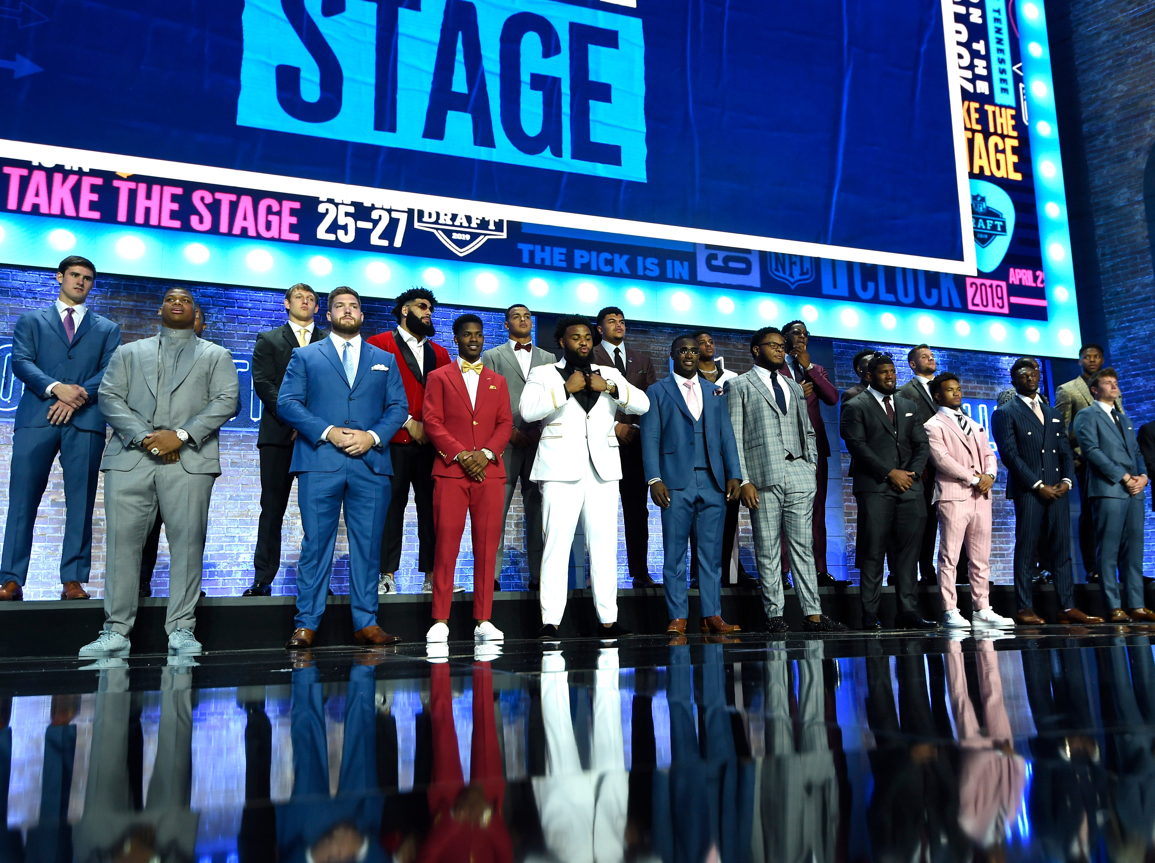 Draft prospects stand on stage for the National Anthem before the start of the first round of the NFL Draft Thursday, April 25, 2019, in Nashville, Tenn.