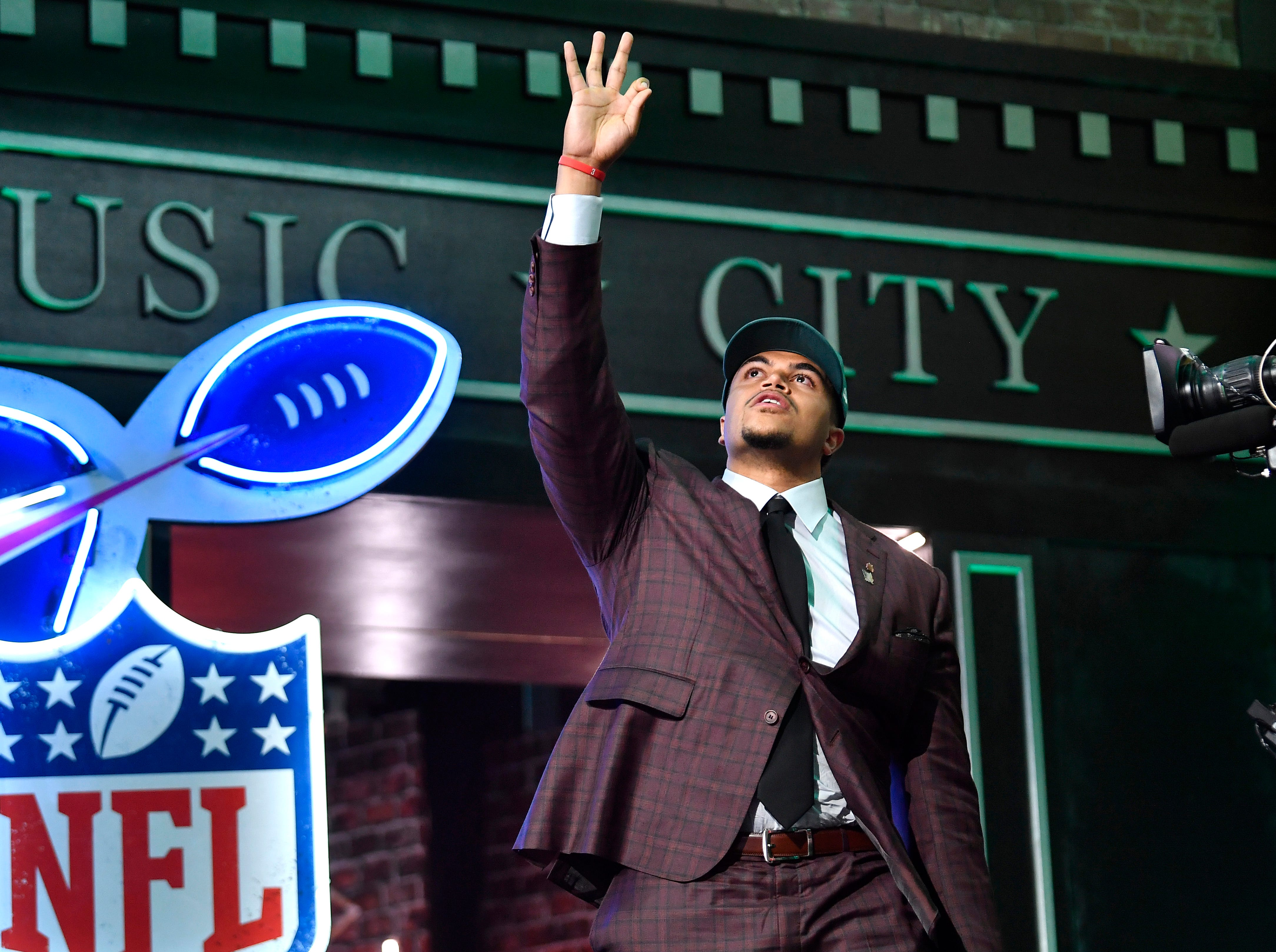 Eagles pick Andre Dillard walks to the stage during the first round of the NFL Draft Thursday, April 25, 2019, in Nashville, Tenn.